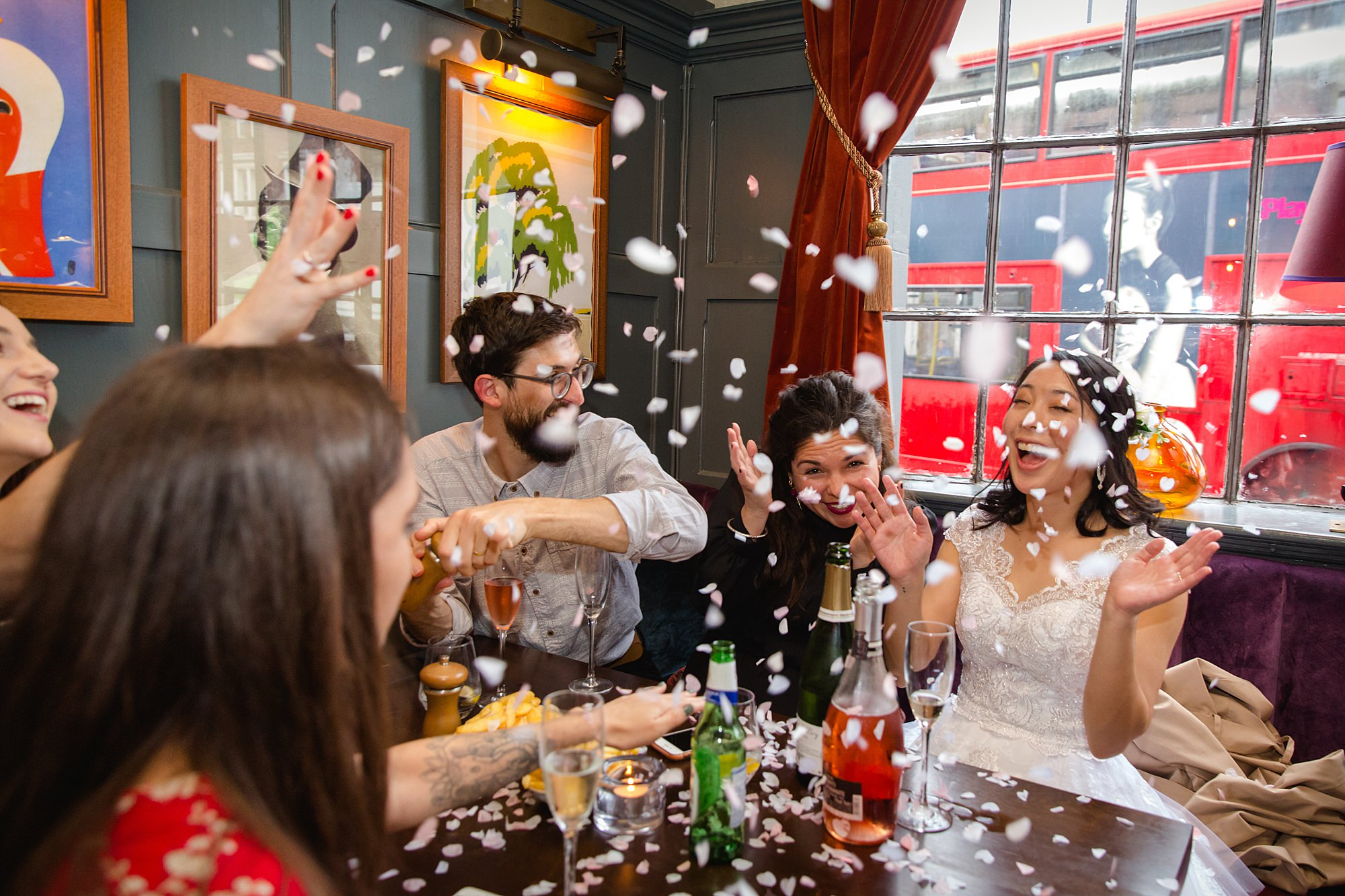 Wandsworth pub wedding bride laughs during confetti shower