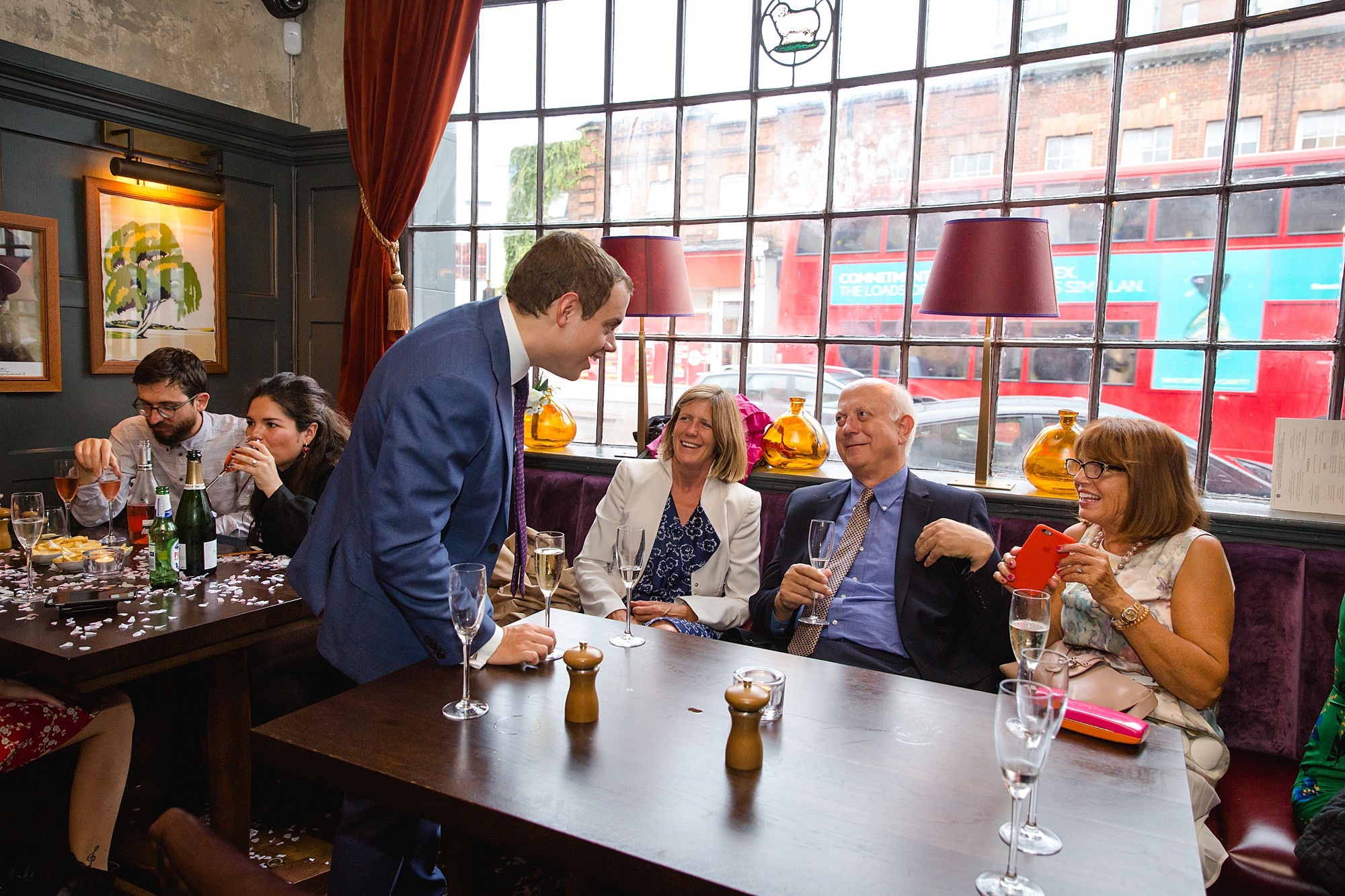 Wandsworth pub wedding groom chats to guests