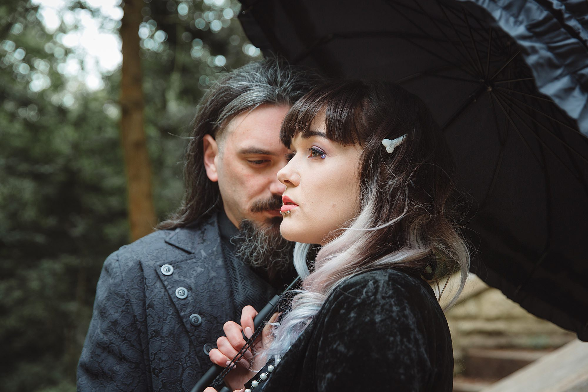 gothic engagement shoot bride and groom with umbrellas