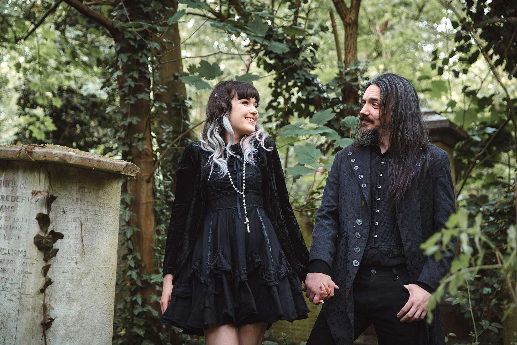 gothic engagement shoot couple laughing