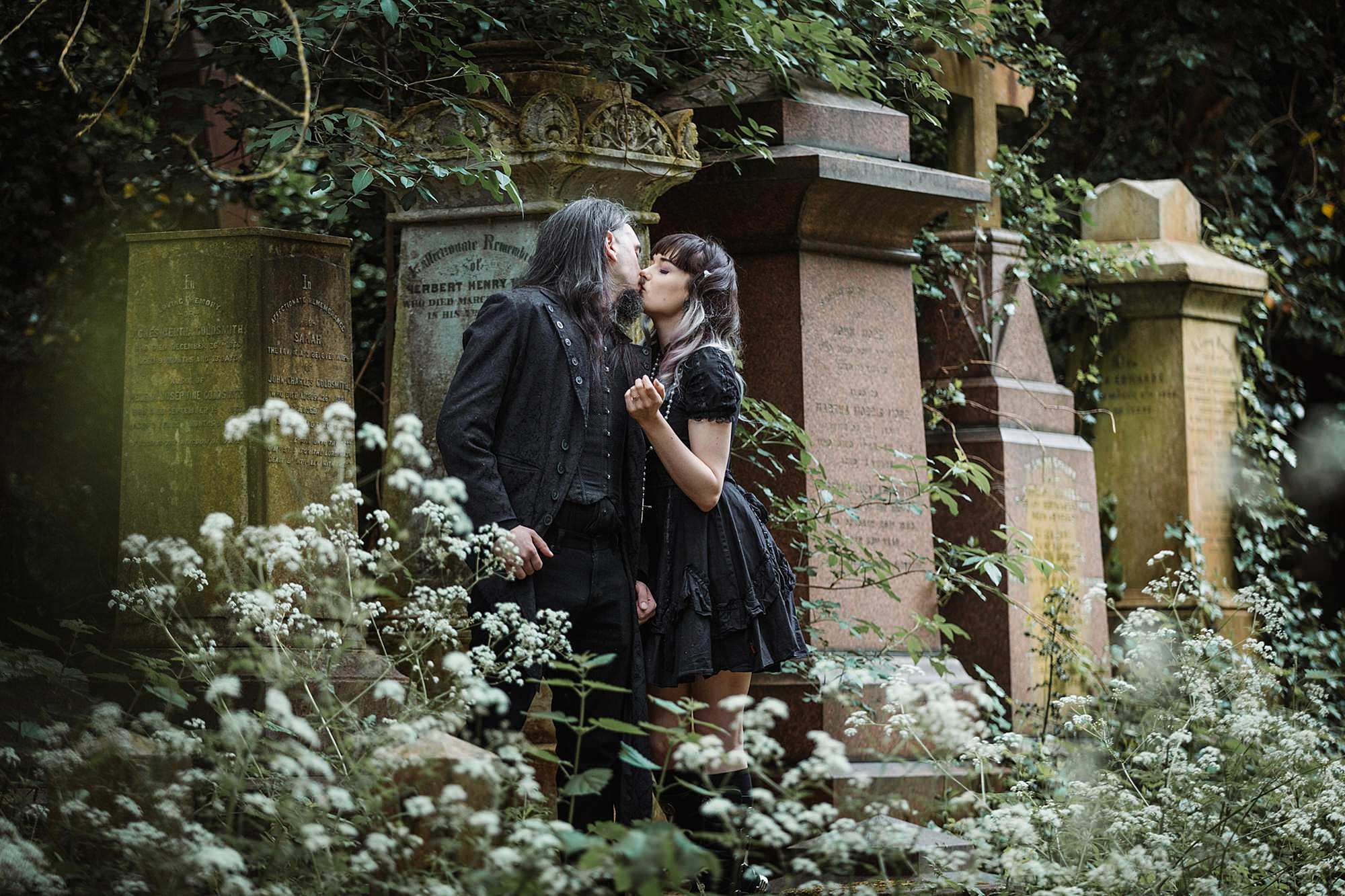 gothic engagement shoot couple kiss