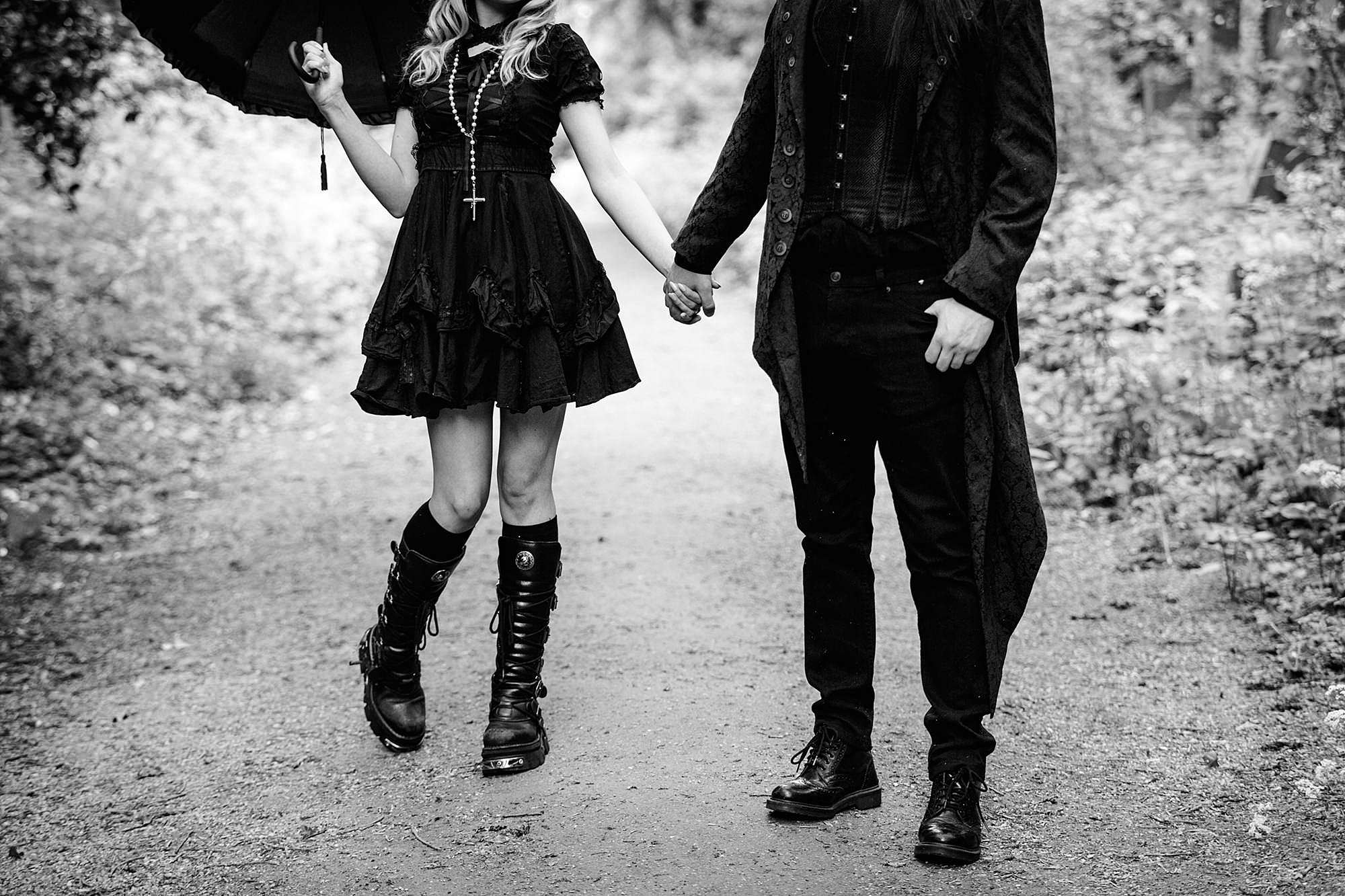 gothic engagement shoot couple holding hands