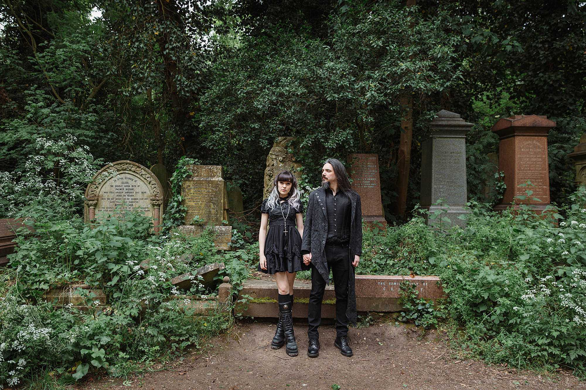 gothic engagement shoot couple on pathway
