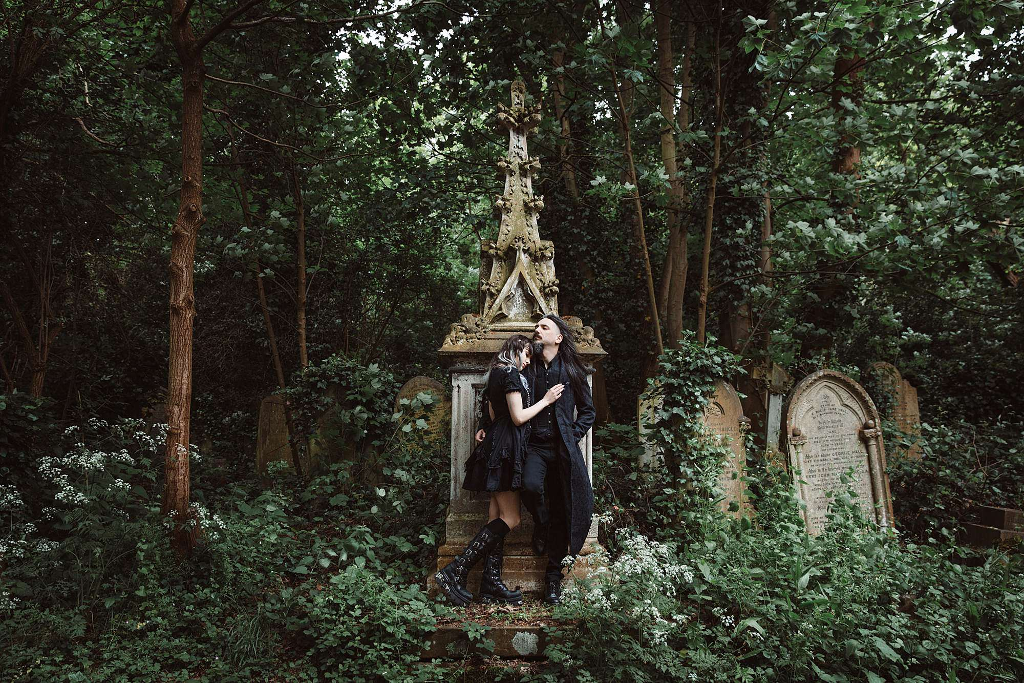 gothic engagement shoot in overgrowth