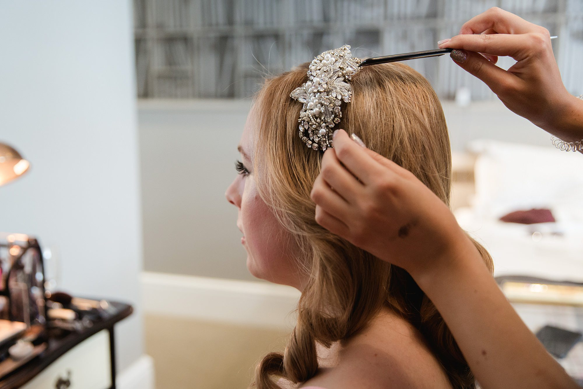 bride having headpiece applied ahead of Harrild and sons wedding