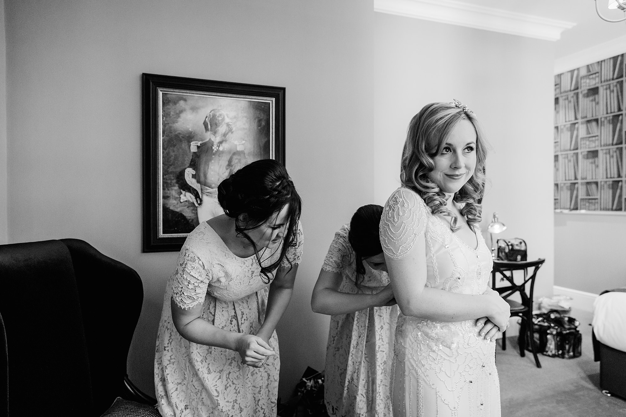 bridesmaids get bride ready for Harrild and sons wedding