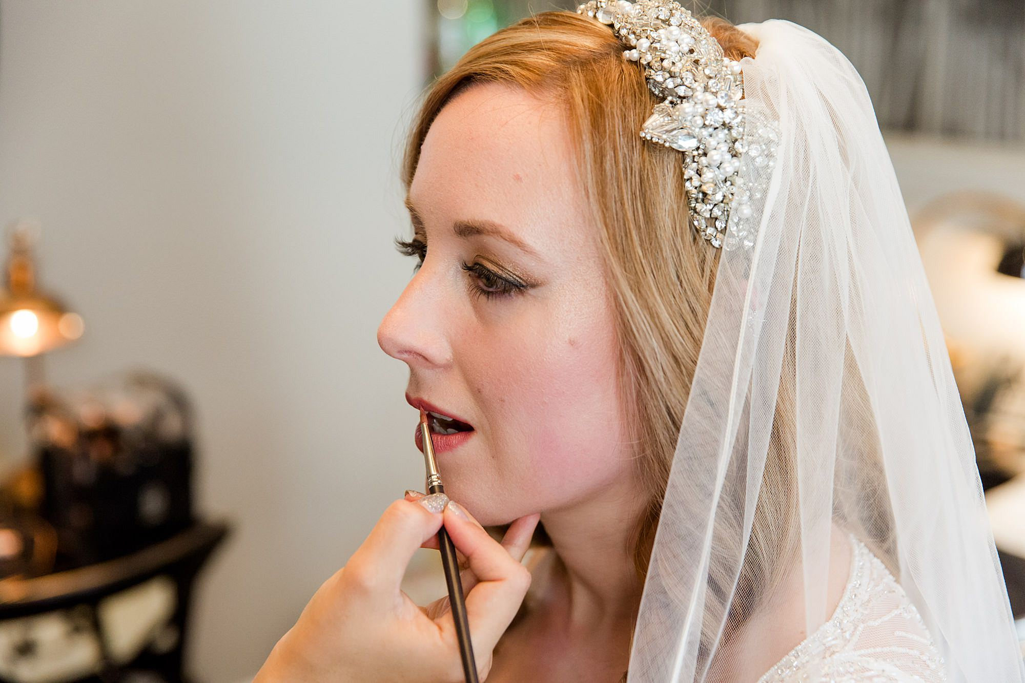 bride has lipstick applied