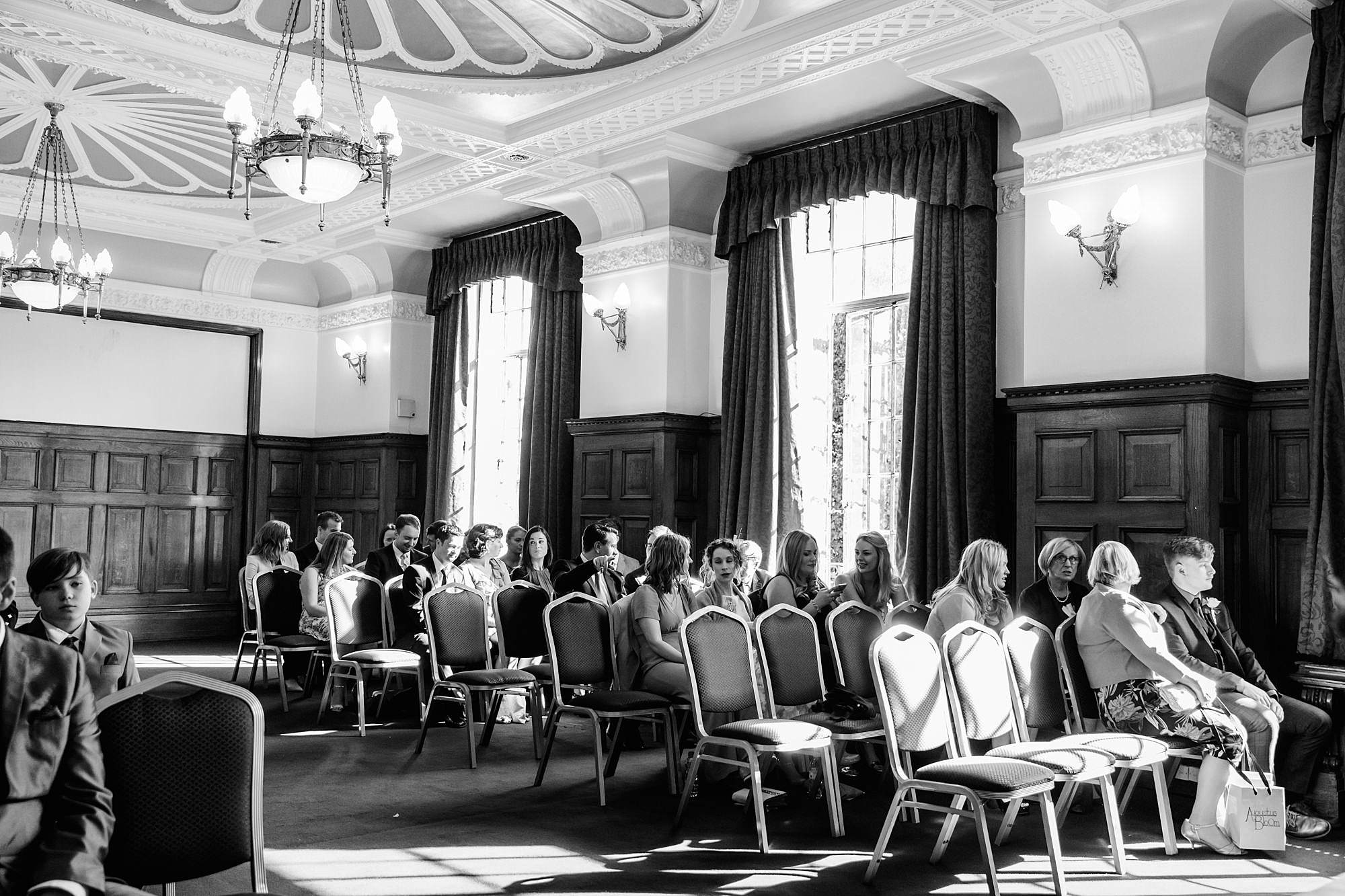 wedding guests waiting in Islington hall ceremony room