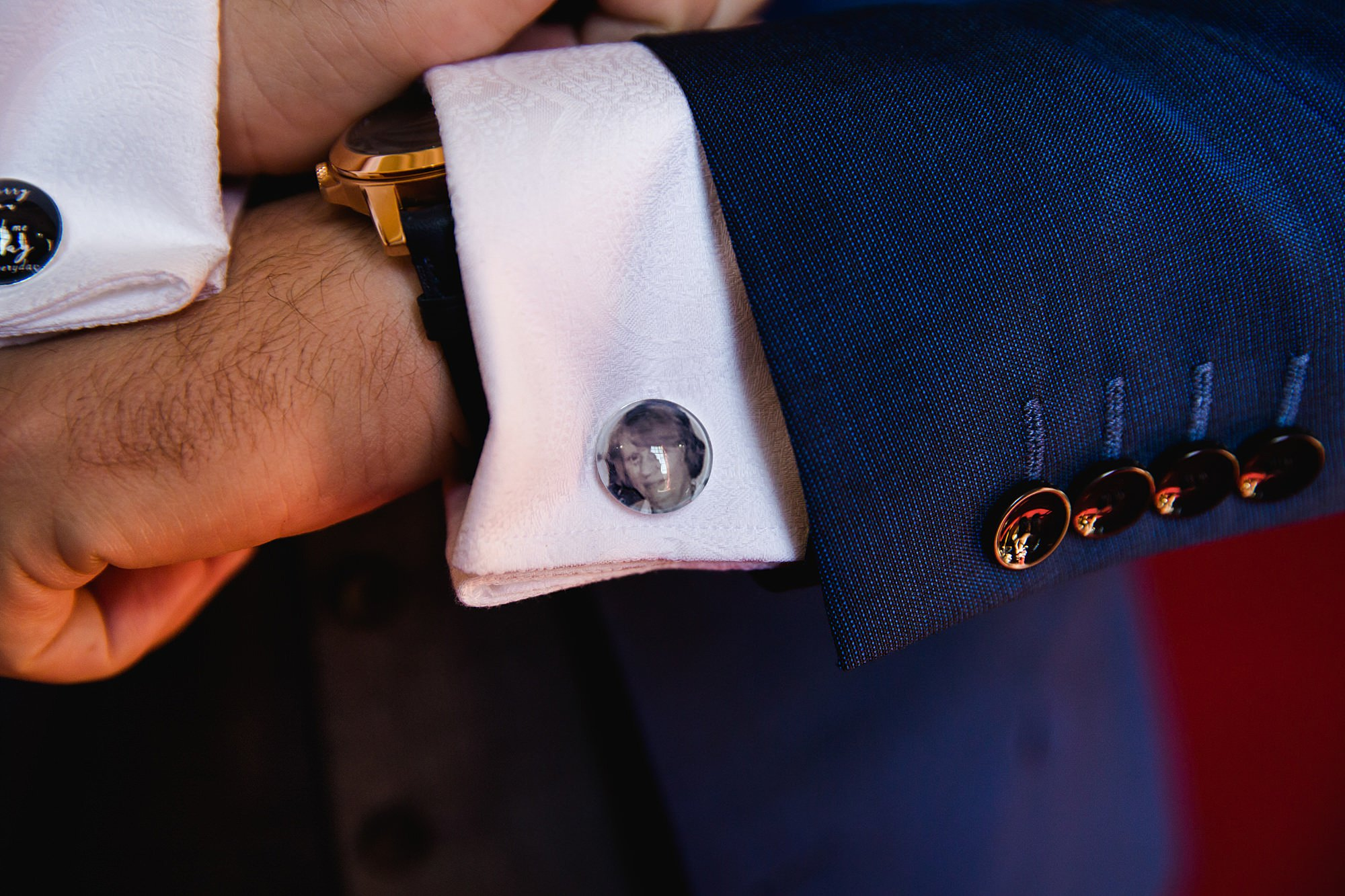 groom shows off his cufflinks