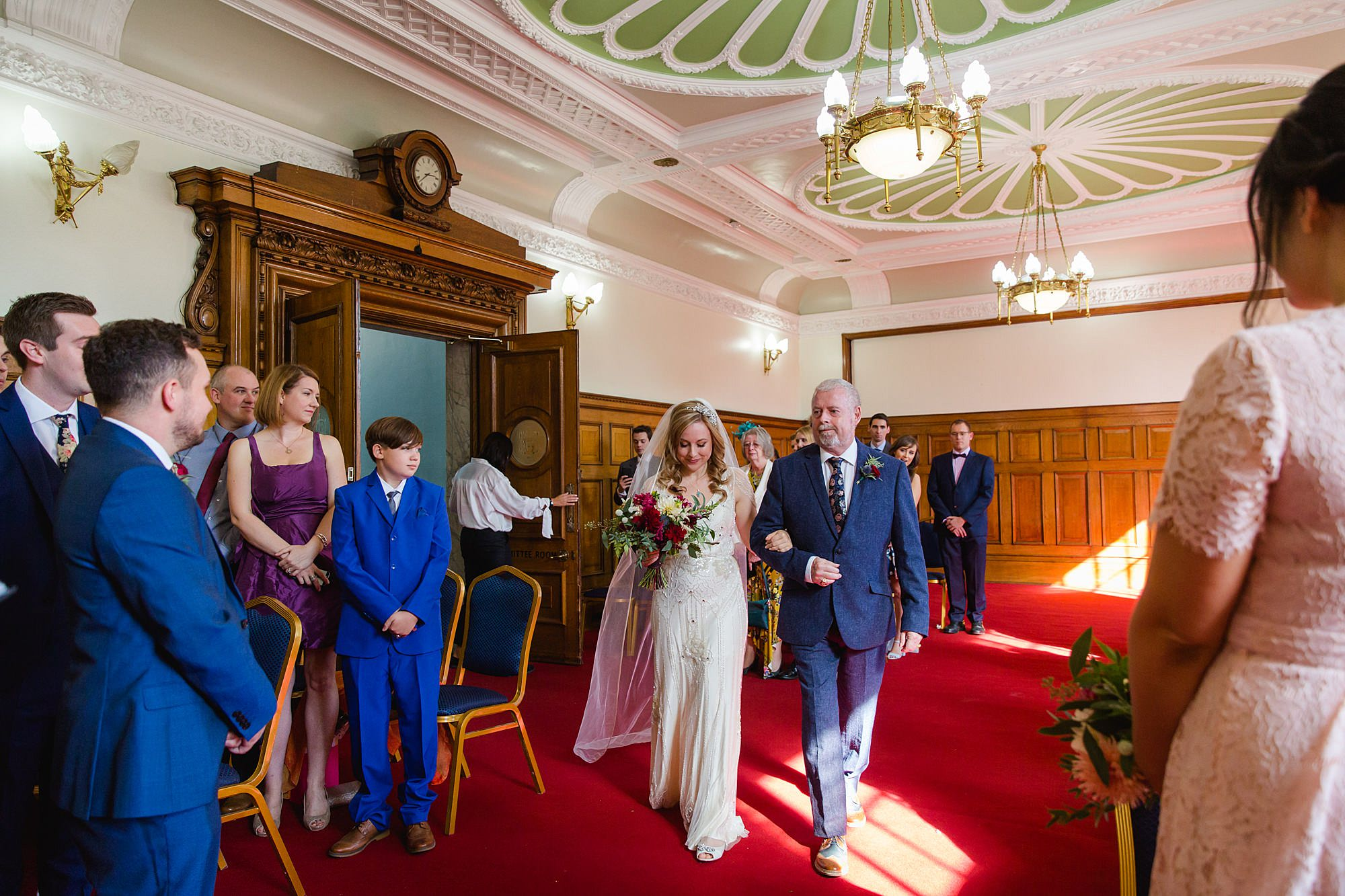 bride walks down the aisle at islington town hall