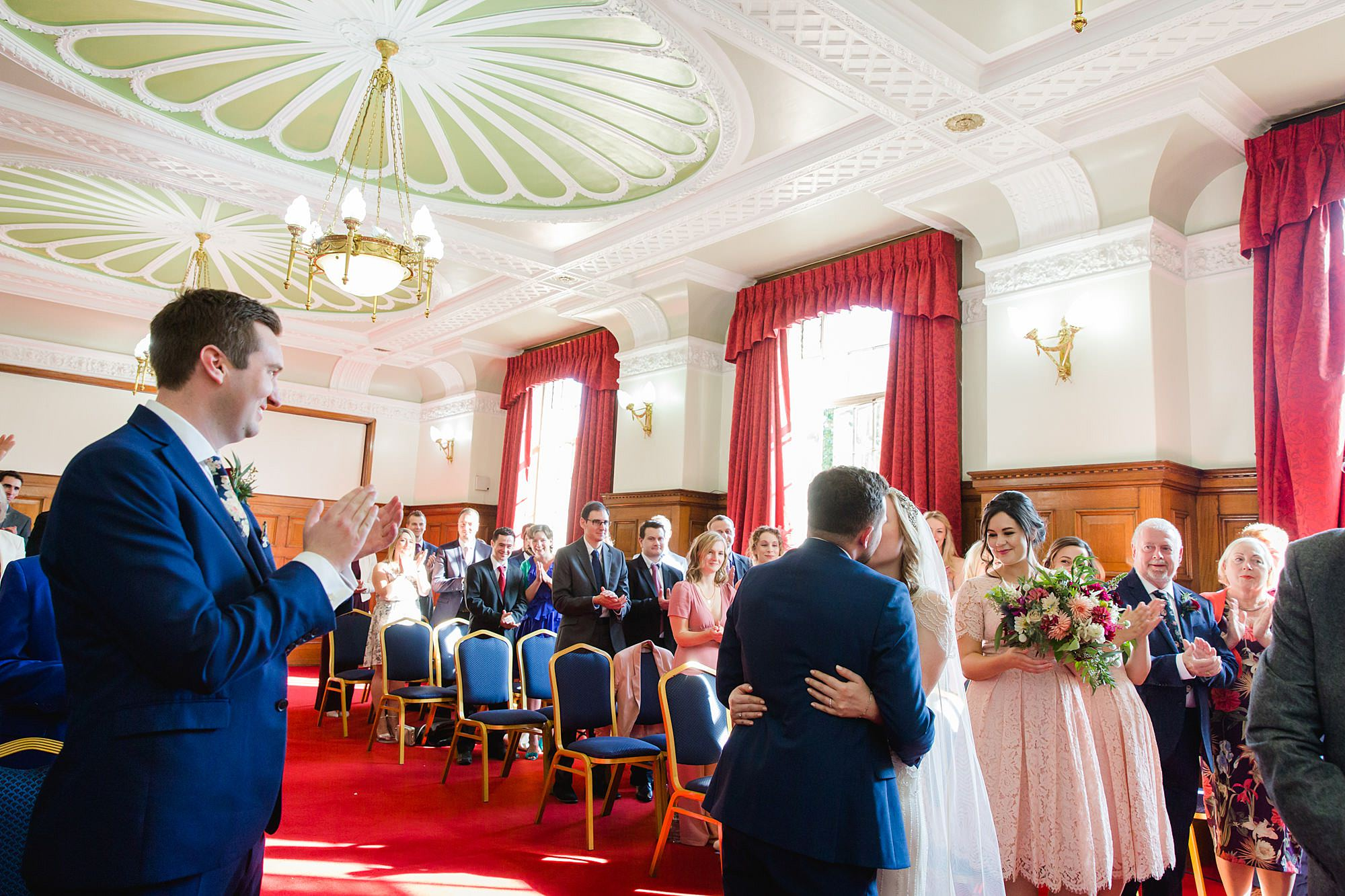bride and groom's first kiss at Harrild and sons wedding