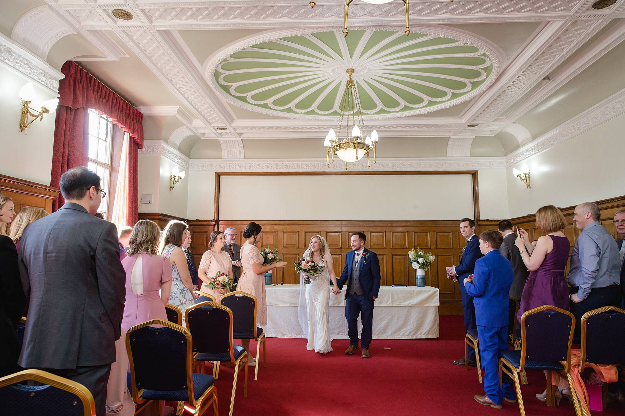 couple walk back down aisle at islington town hall