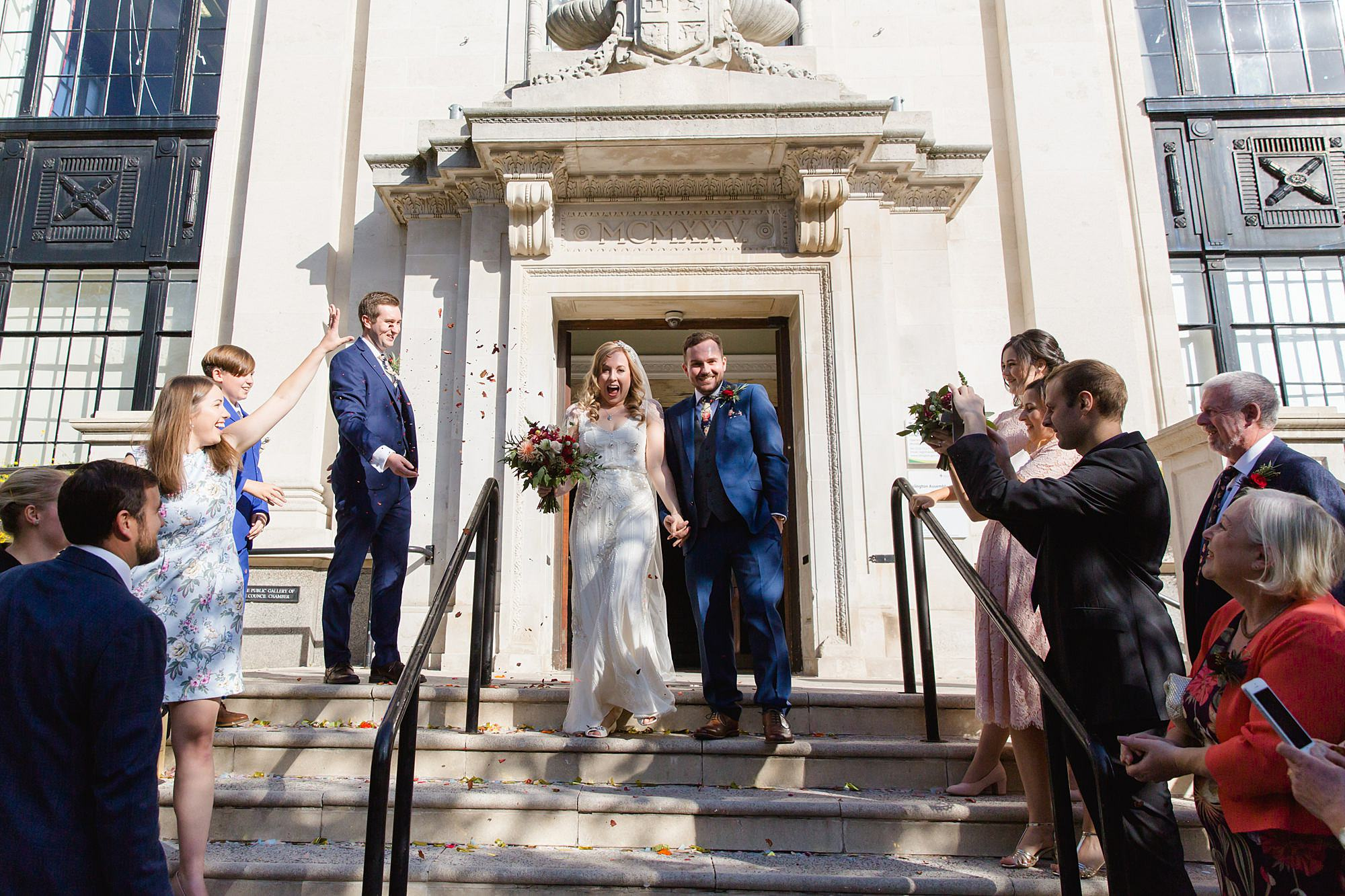 bride and groom emerge from town hall for Harrild and sons wedding