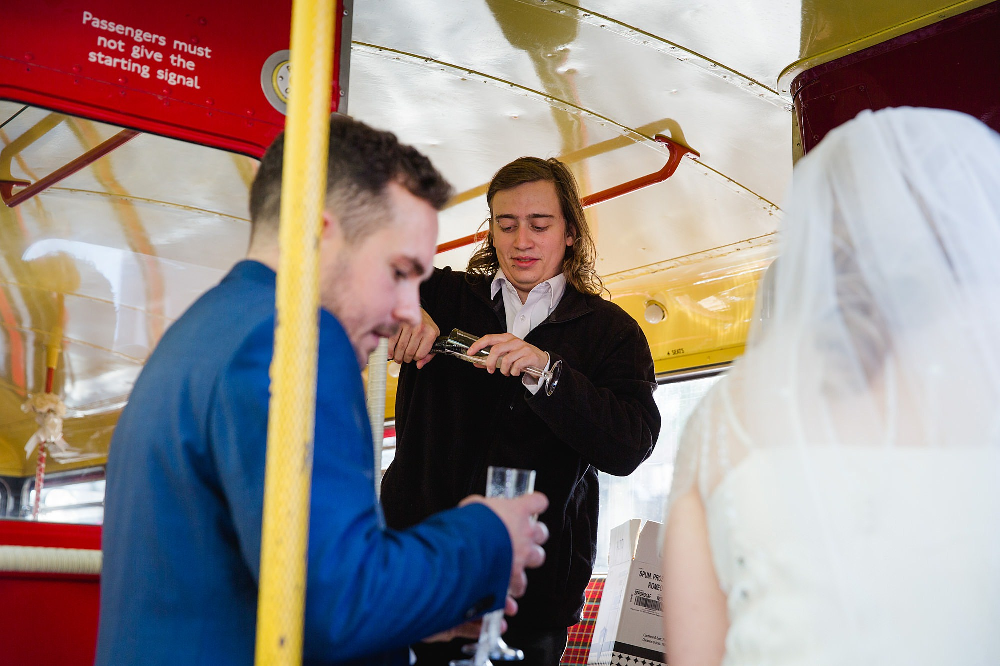 Harrild and sons wedding bride and groom having drink on bus