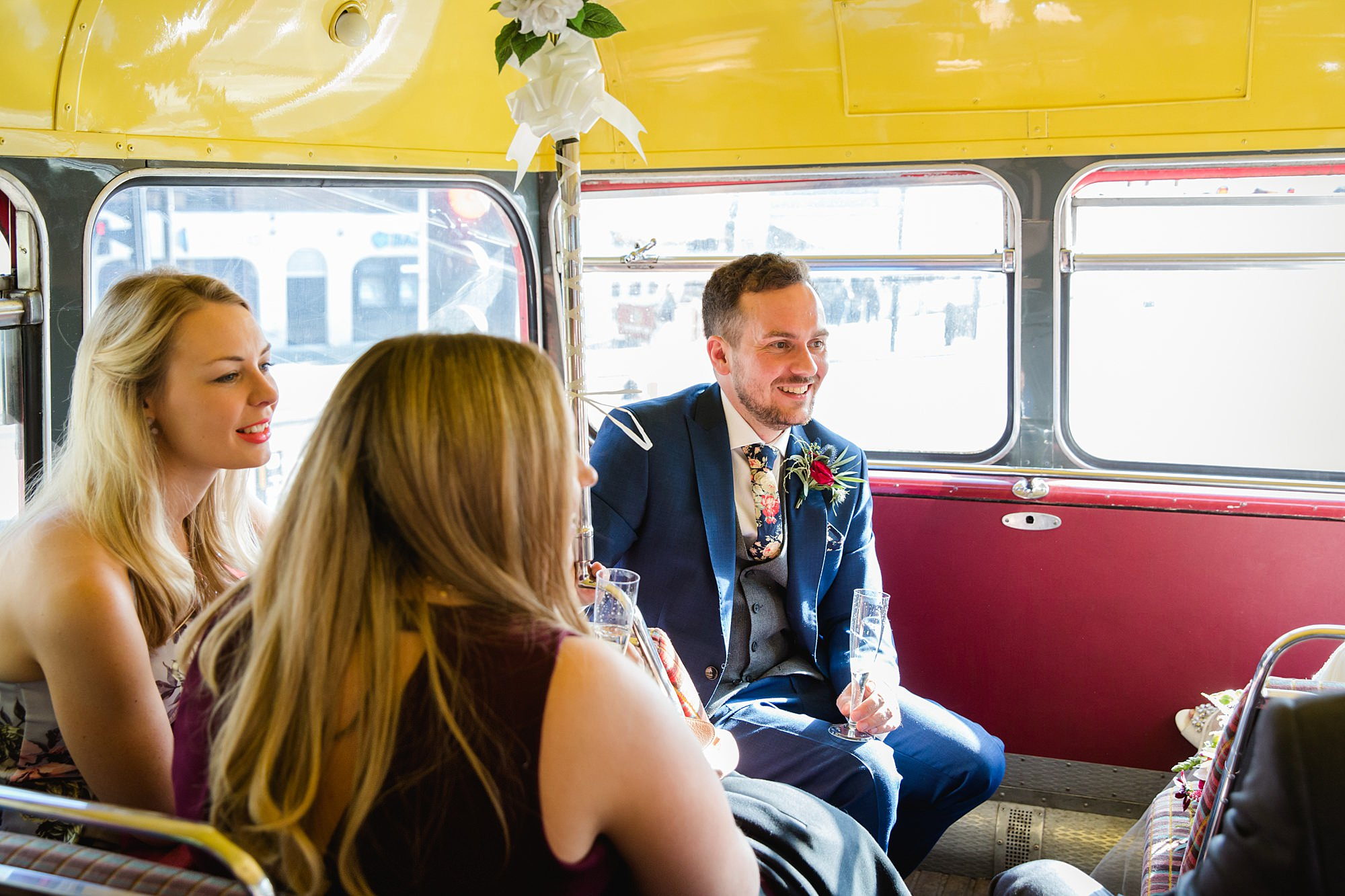 groom on wedding bus to Harrild and sons wedding