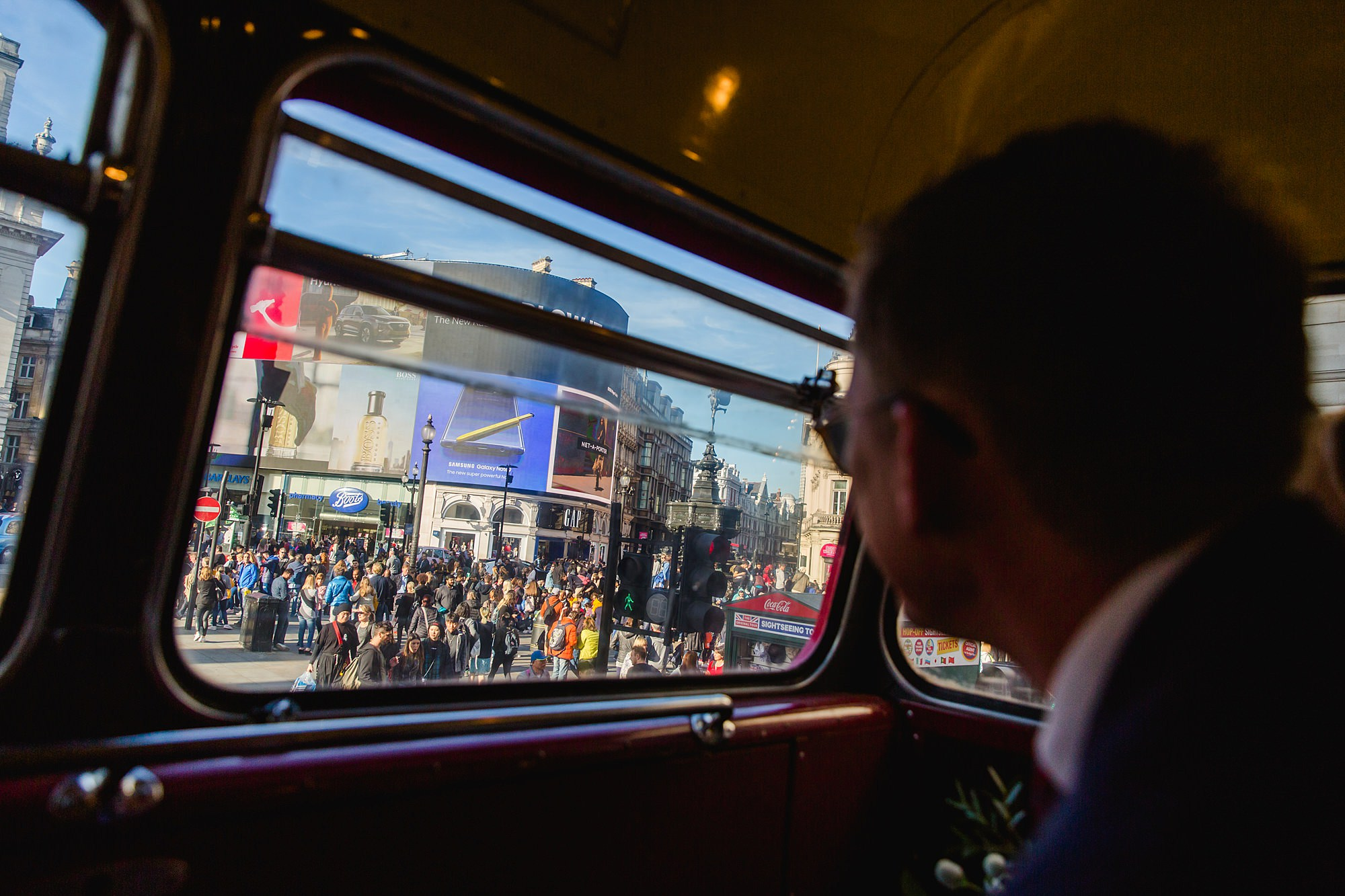 guest looks out at view of London from bus