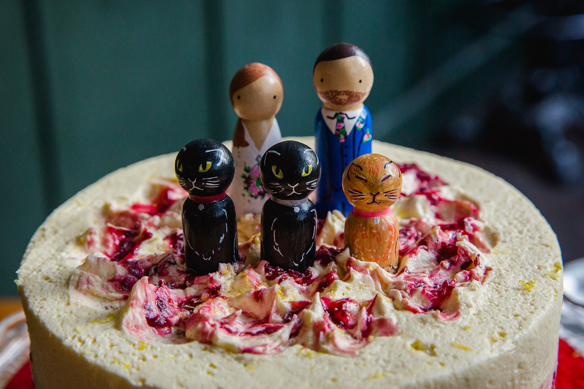 Harrild and sons wedding cake topper of couple with their cats