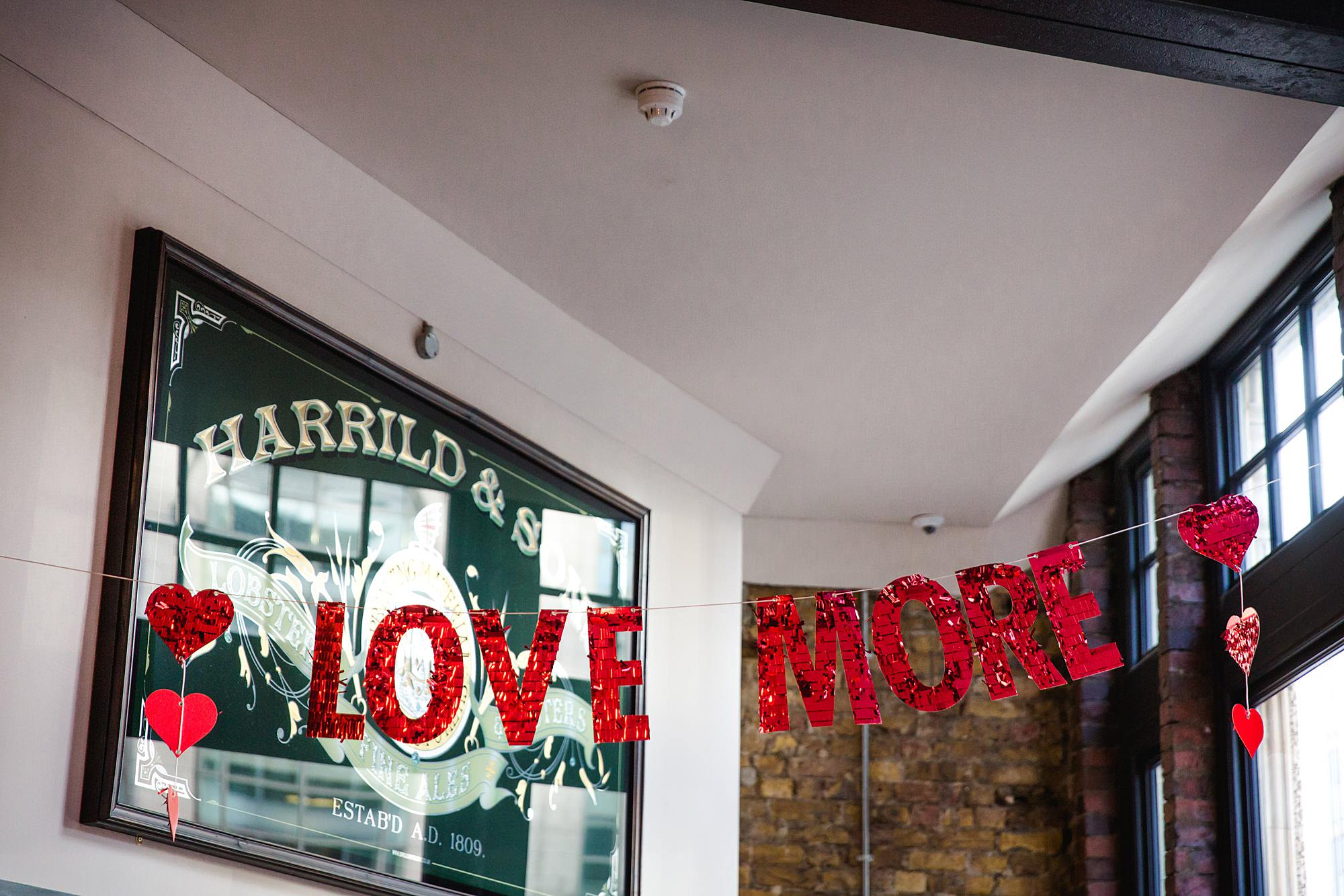 "Harrild and sons wedding ""love more"" wedding sign"