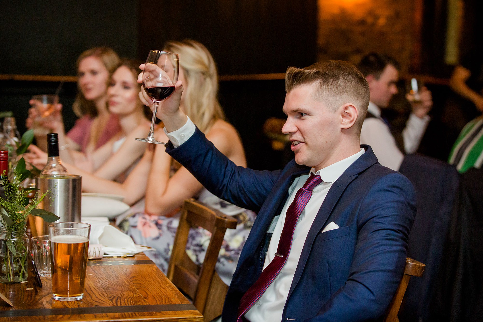 Harrild and sons wedding guests toast during speeches