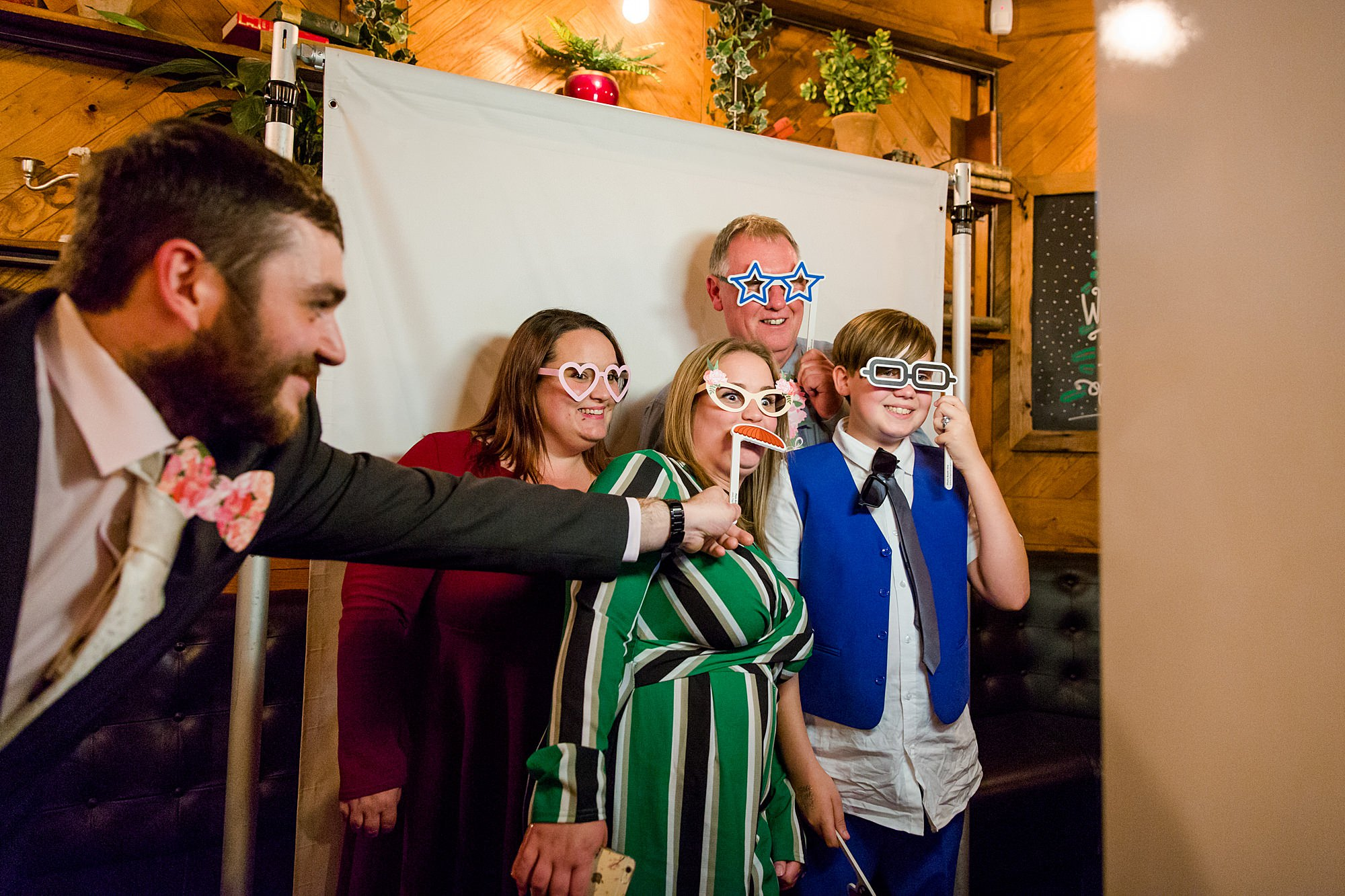 guests play with Photo Booth props at Harrild and sons wedding