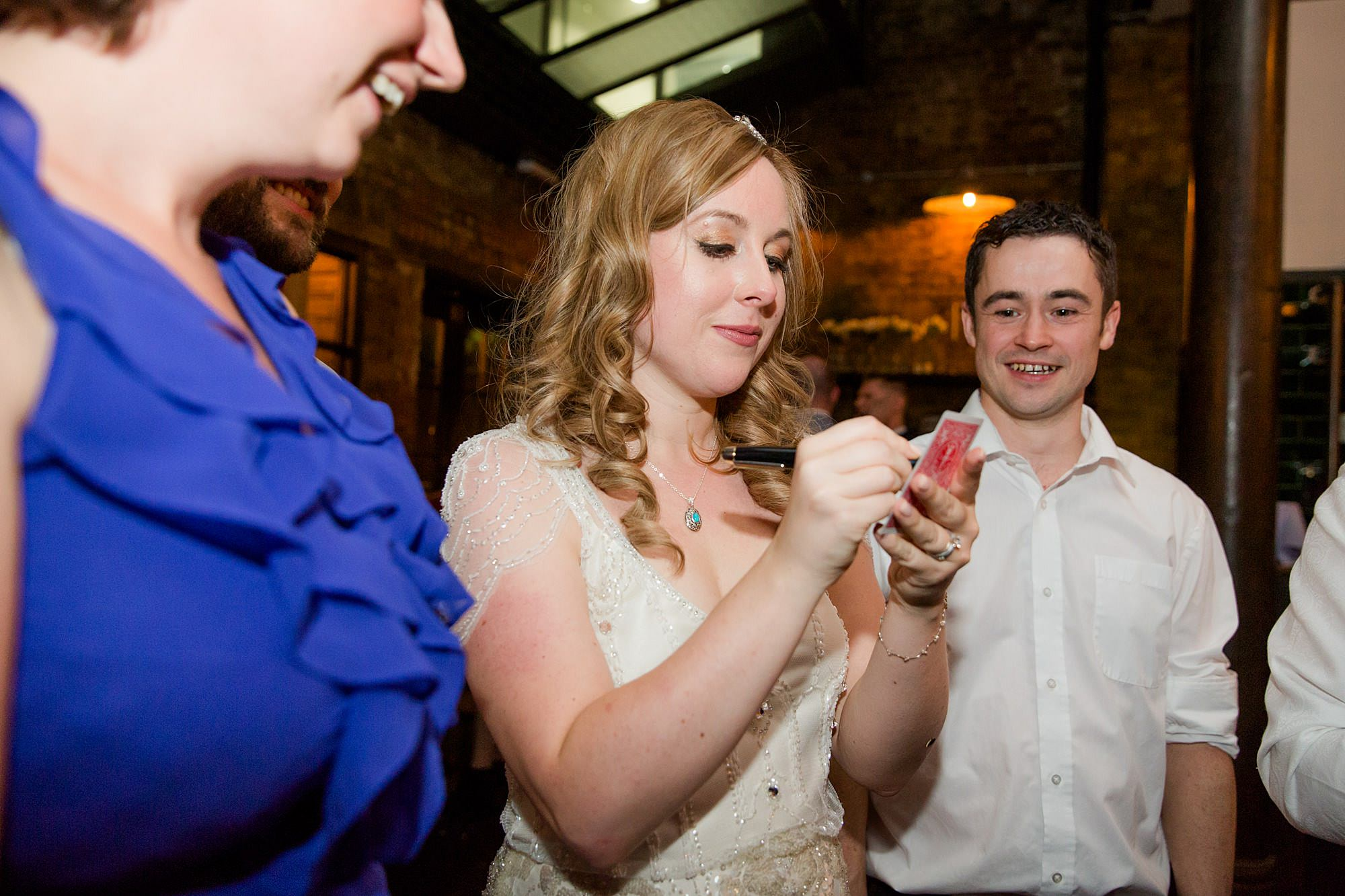 bride takes part in magic trick