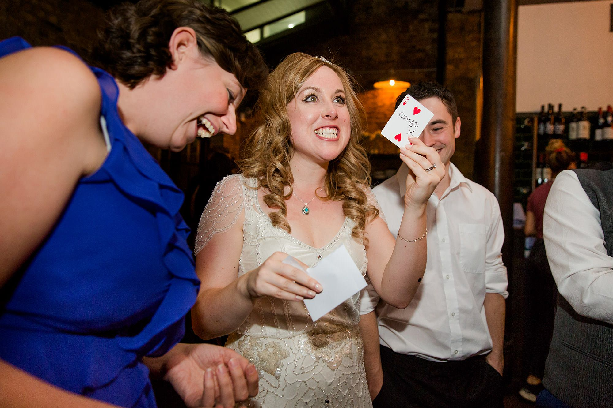 bride laughs at magic trick st Harrild and sons wedding