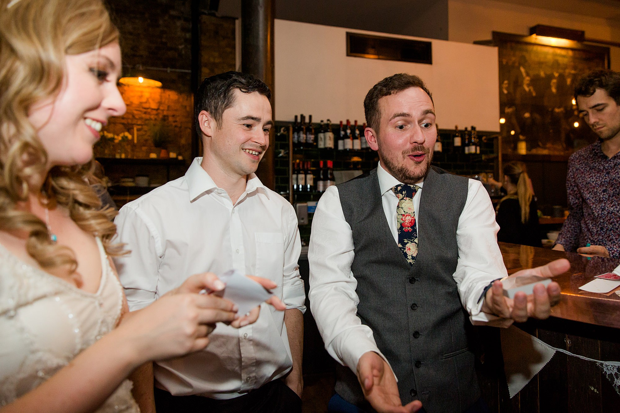groom surprised by magic trick at Harrild and sons wedding