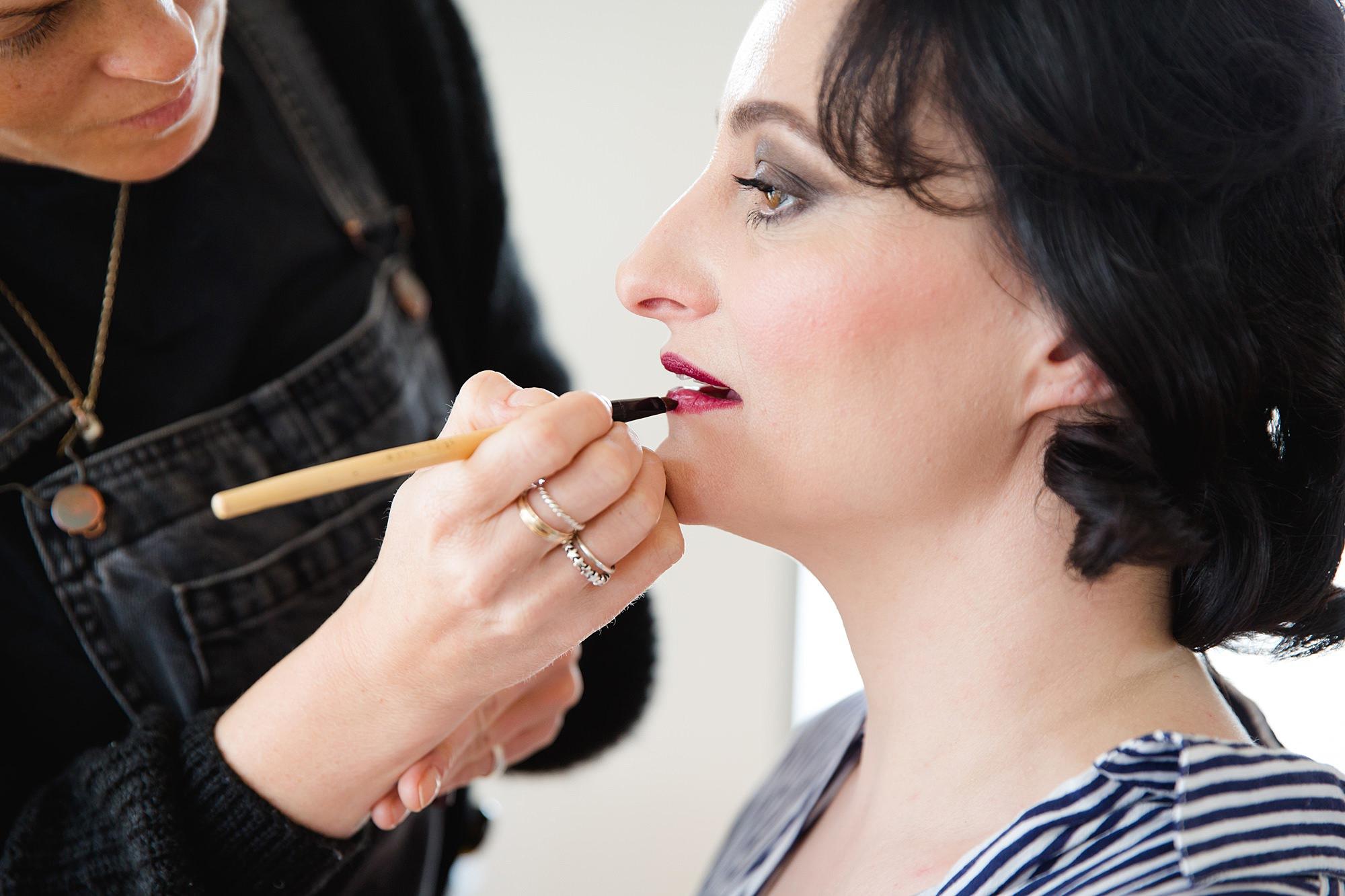 Brunel museum wedding bride has lipstick applied