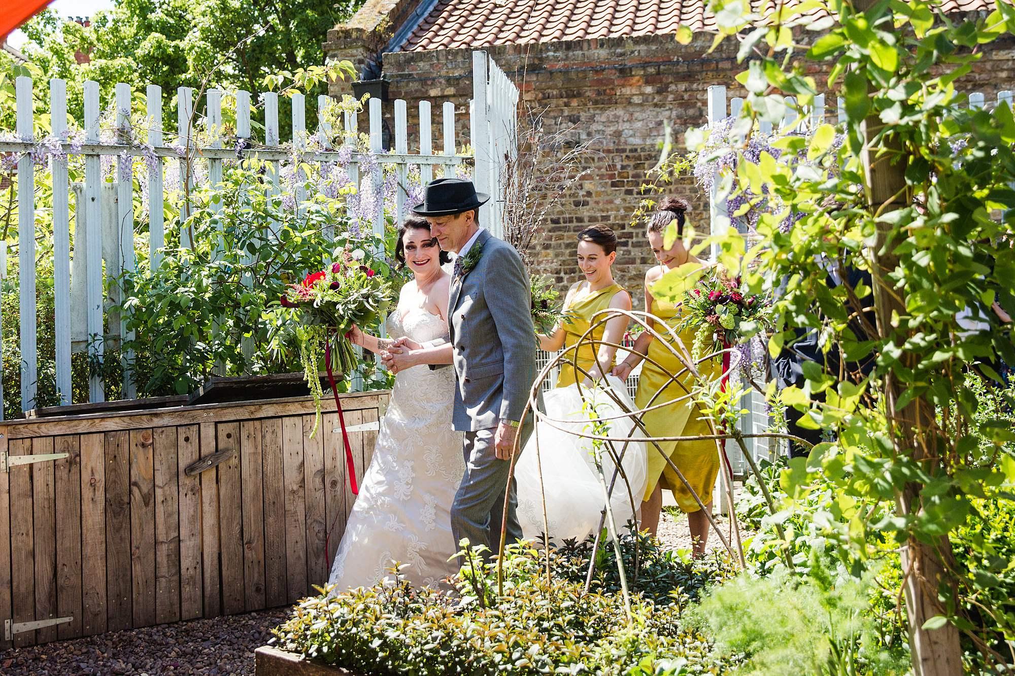 Brunel museum wedding bride walks into garden