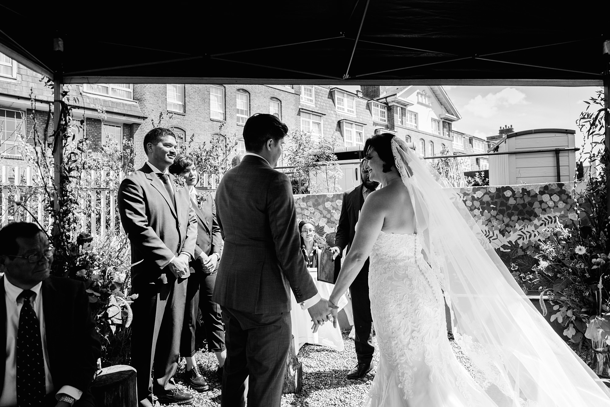 Brunel museum wedding bride greets groom at ceremony