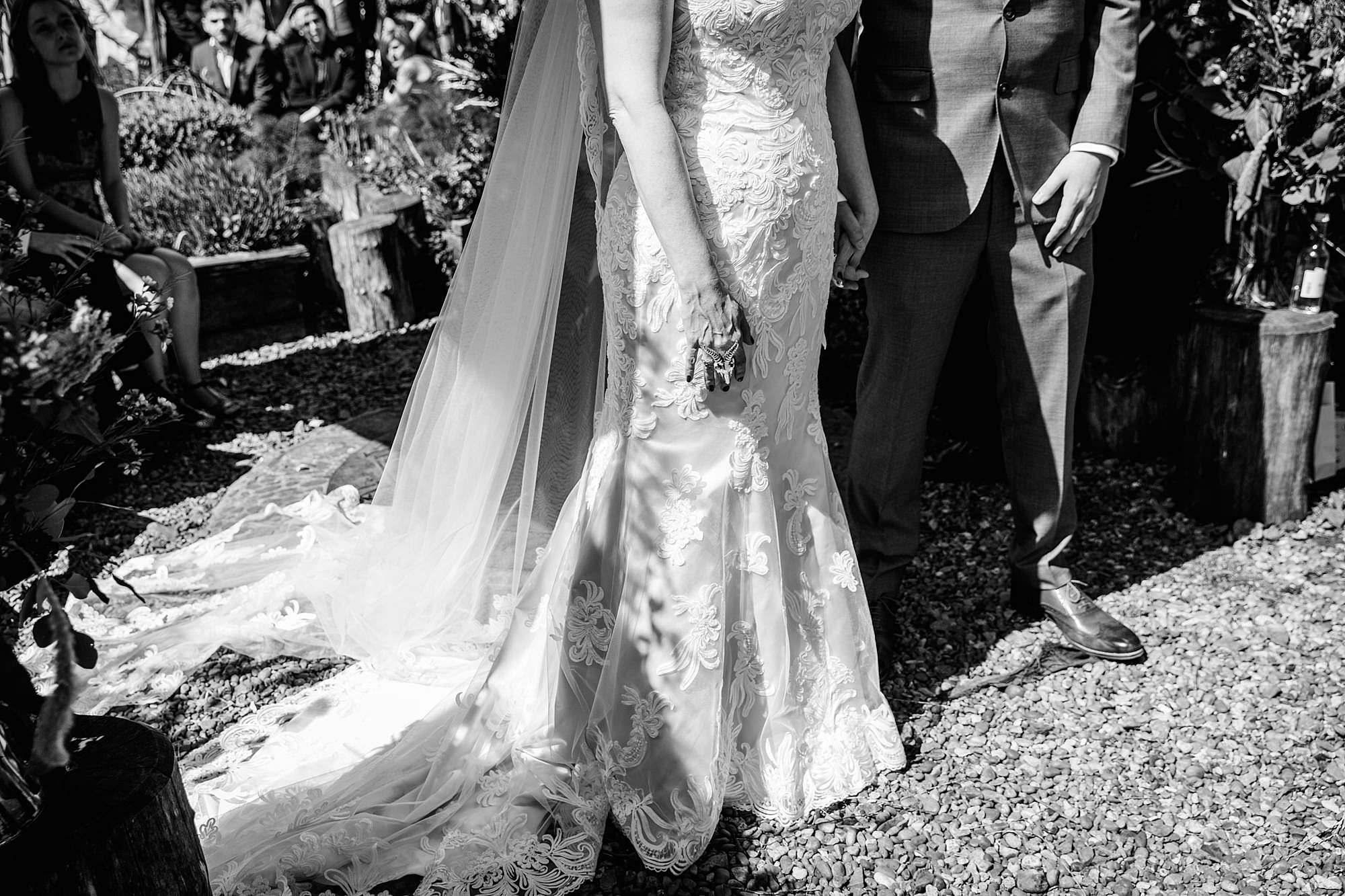 Brunel museum wedding bride and groom hold hands in ceremony