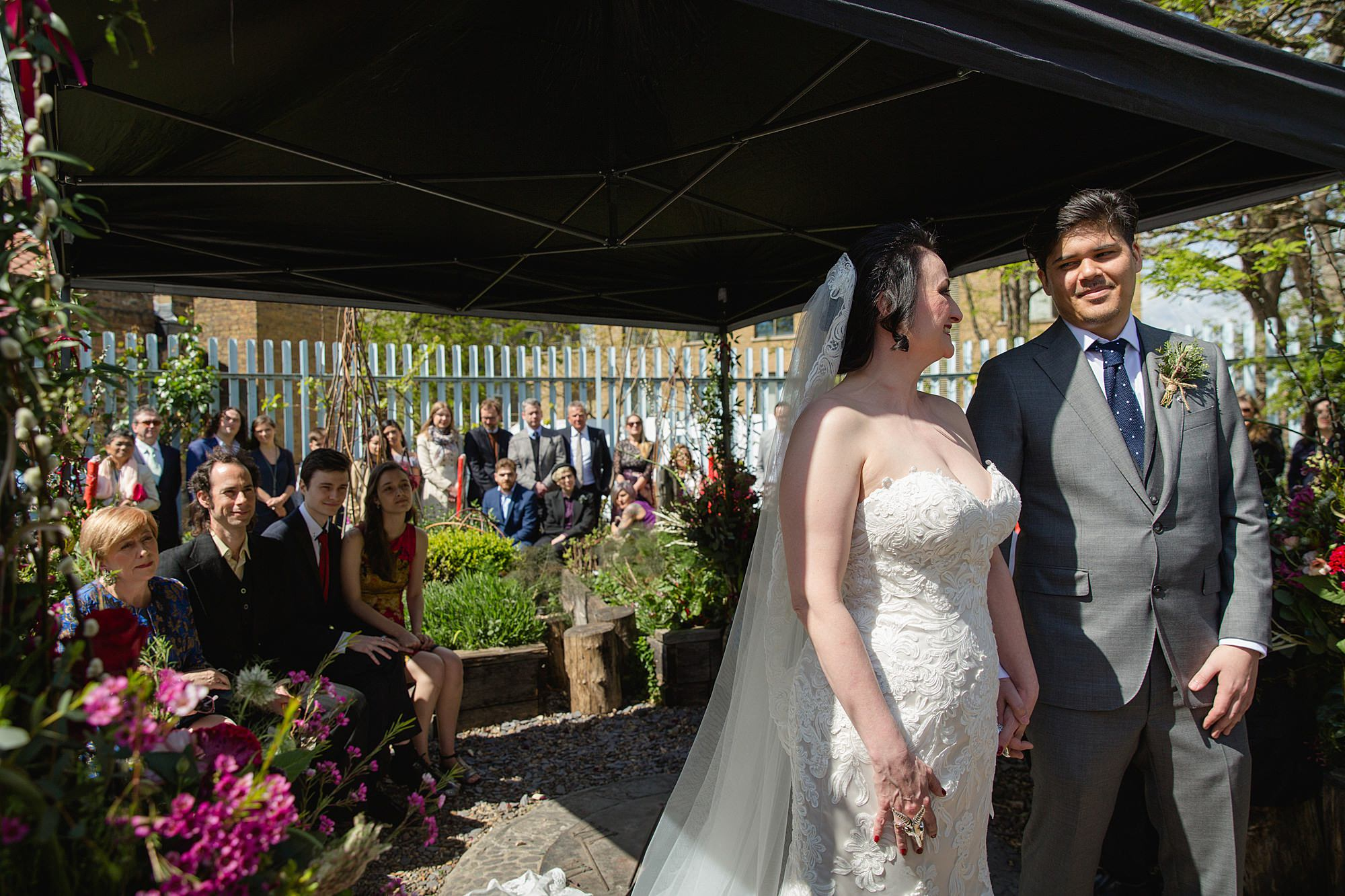 Brunel museum wedding bride and groom smile during wedding ceremony