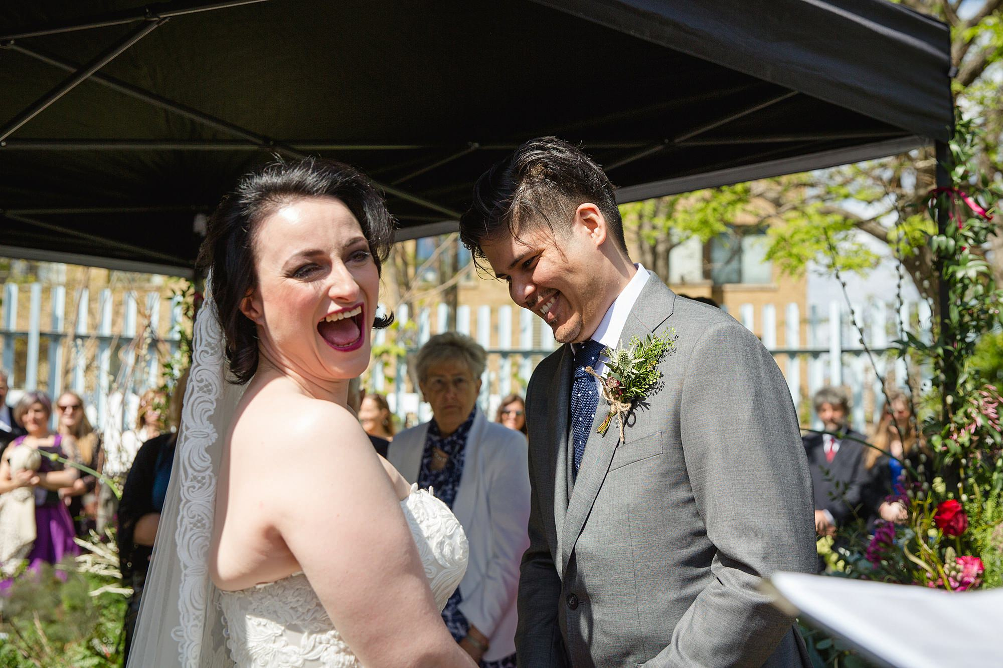 Brunel museum wedding bride and groom laugh during ceremony
