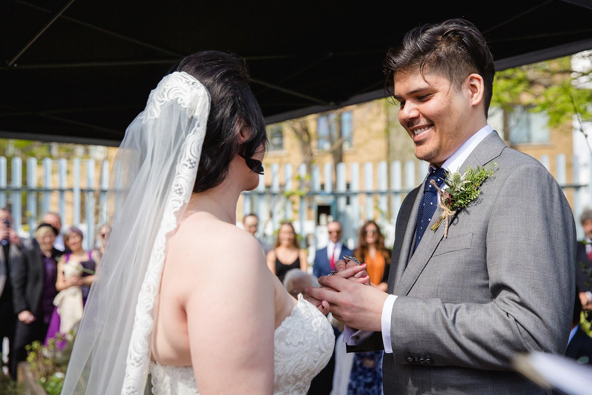 Brunel museum wedding bride and groom exchange rings