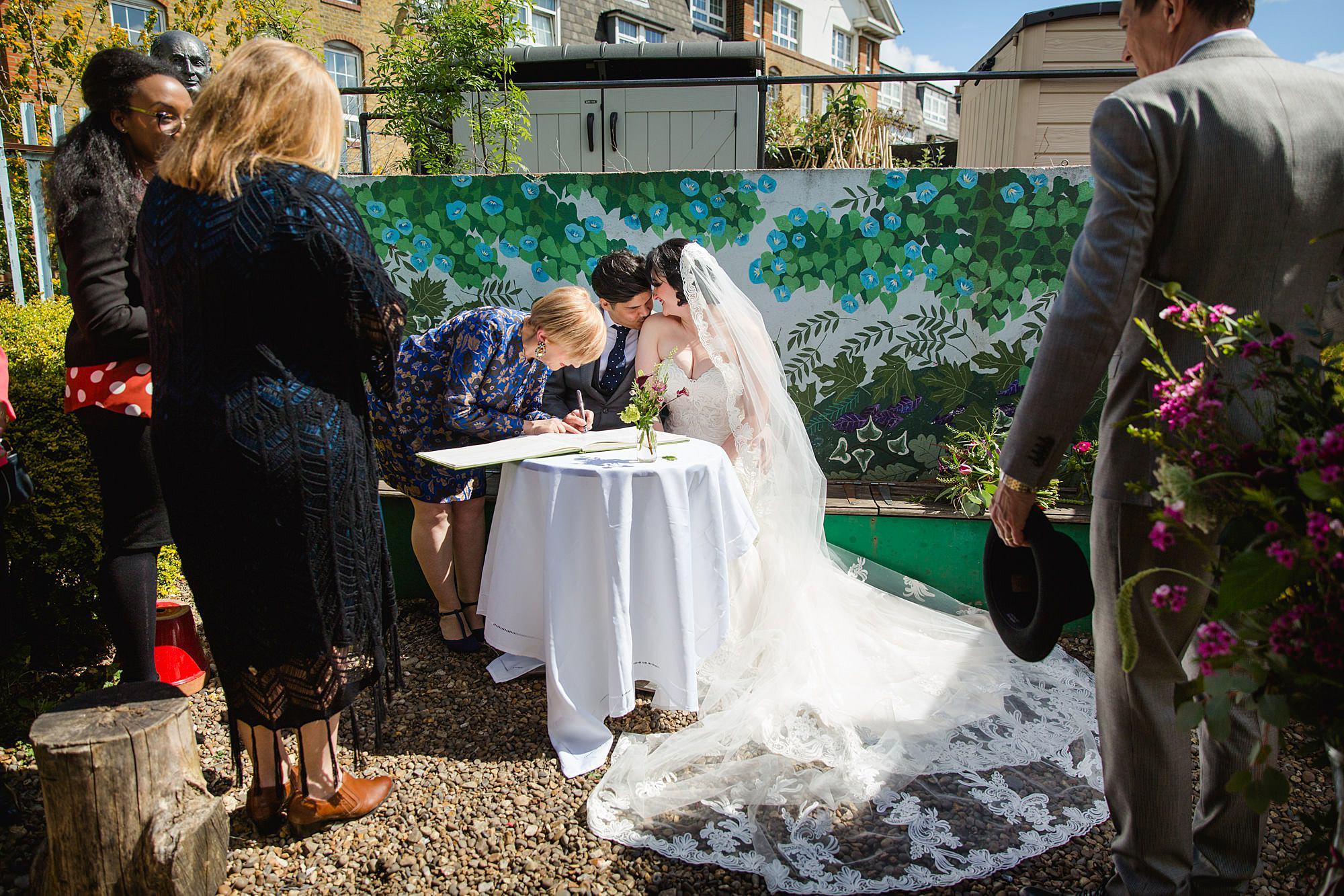 Brunel museum wedding bride and groom signing register