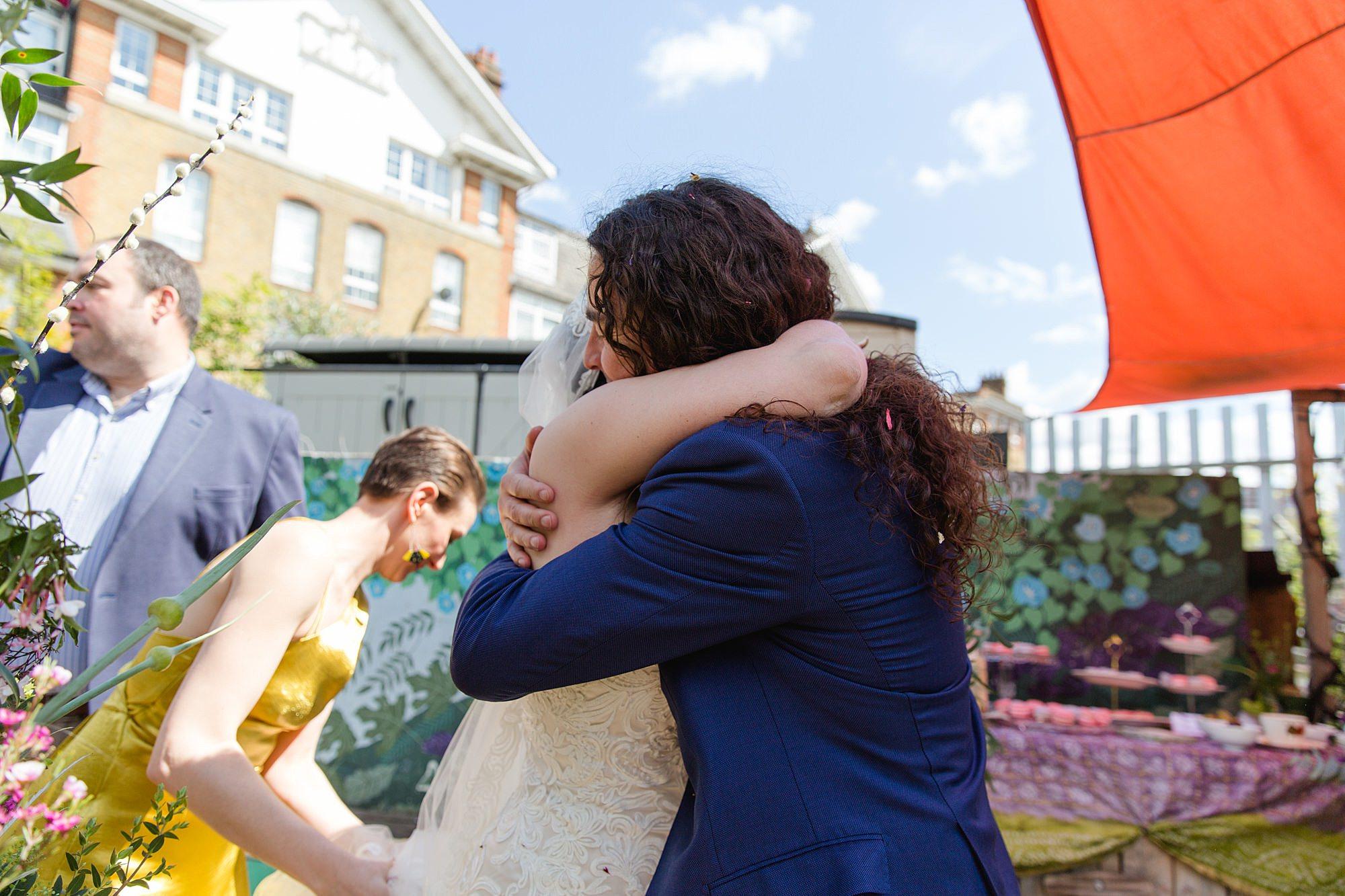 Brunel museum wedding guest hugging bride after ceremony