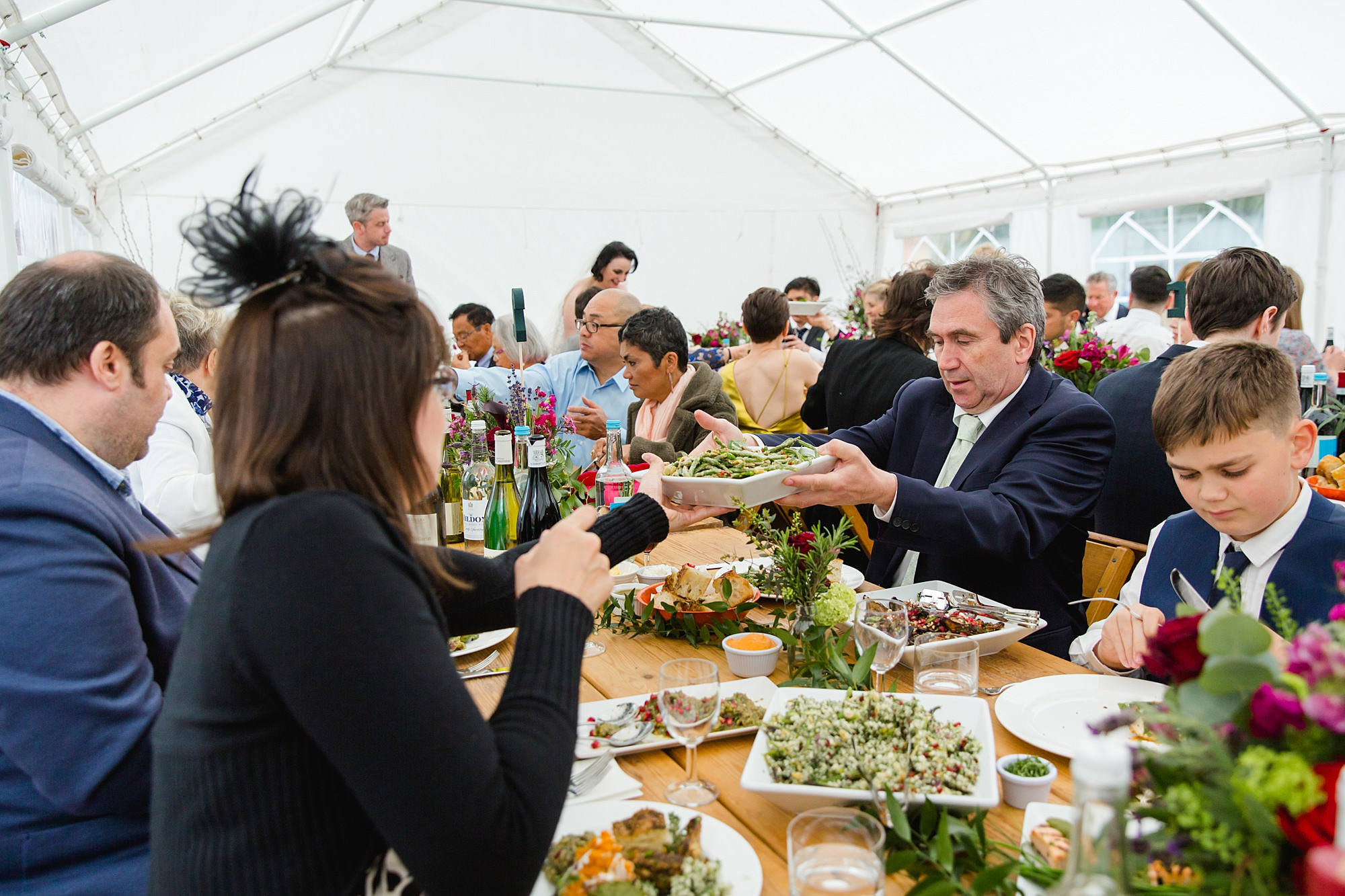 guests sharing food at brunel museum wedding
