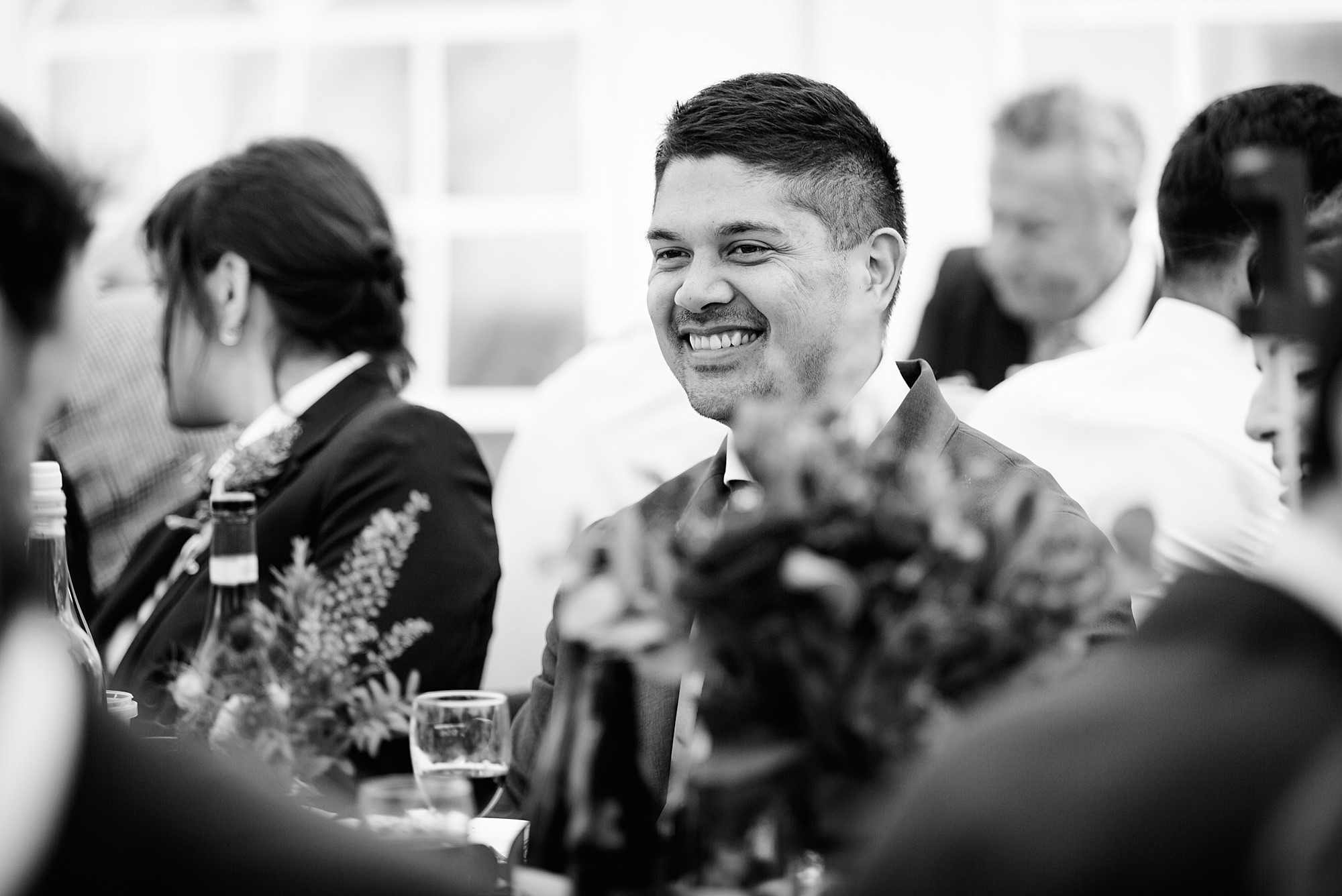 wedding guest laughing during dinner