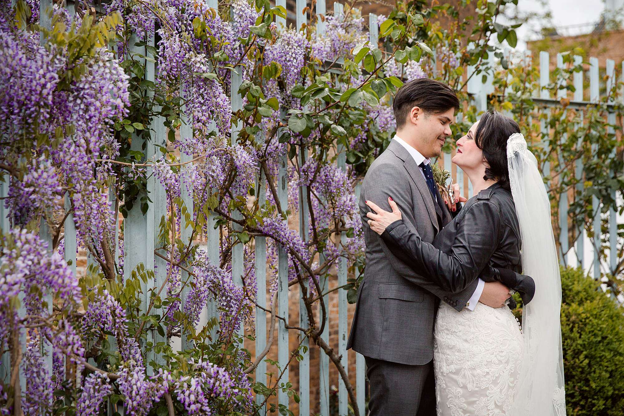 Brunel museum wedding bride and groom with wisteria