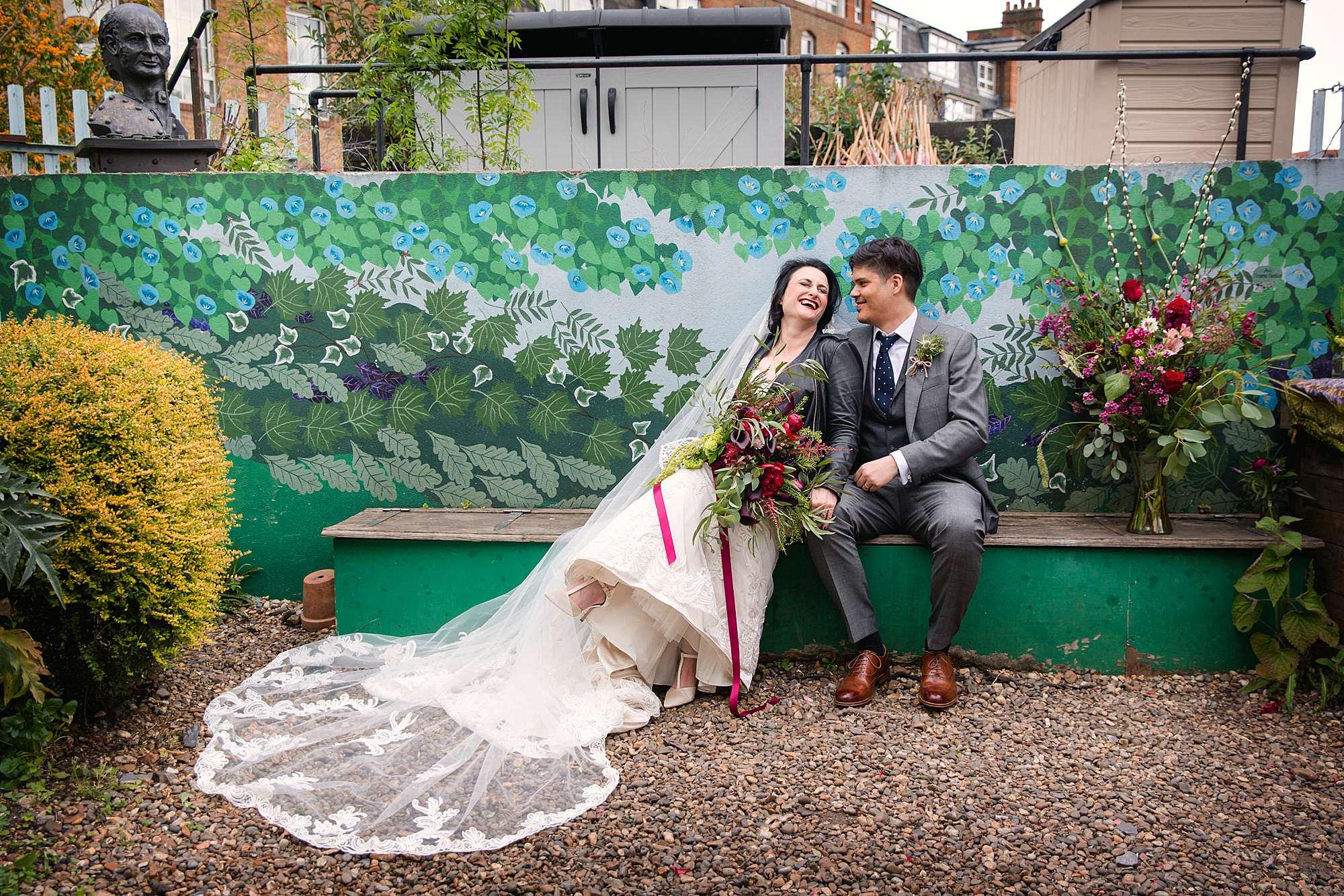 Brunel museum wedding bride and groom sat on garden bench