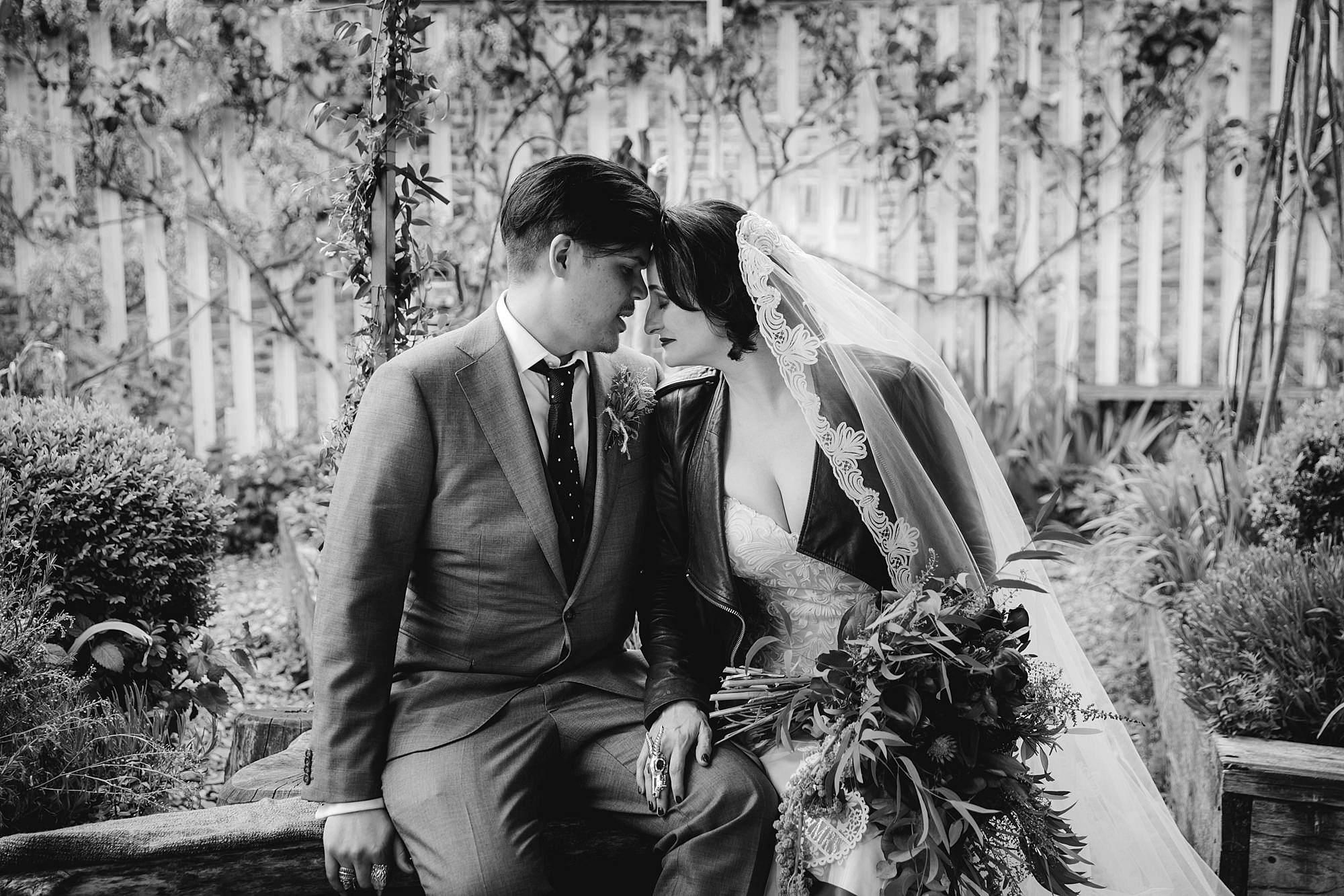 Brunel museum wedding groom and bride sit on garden bench