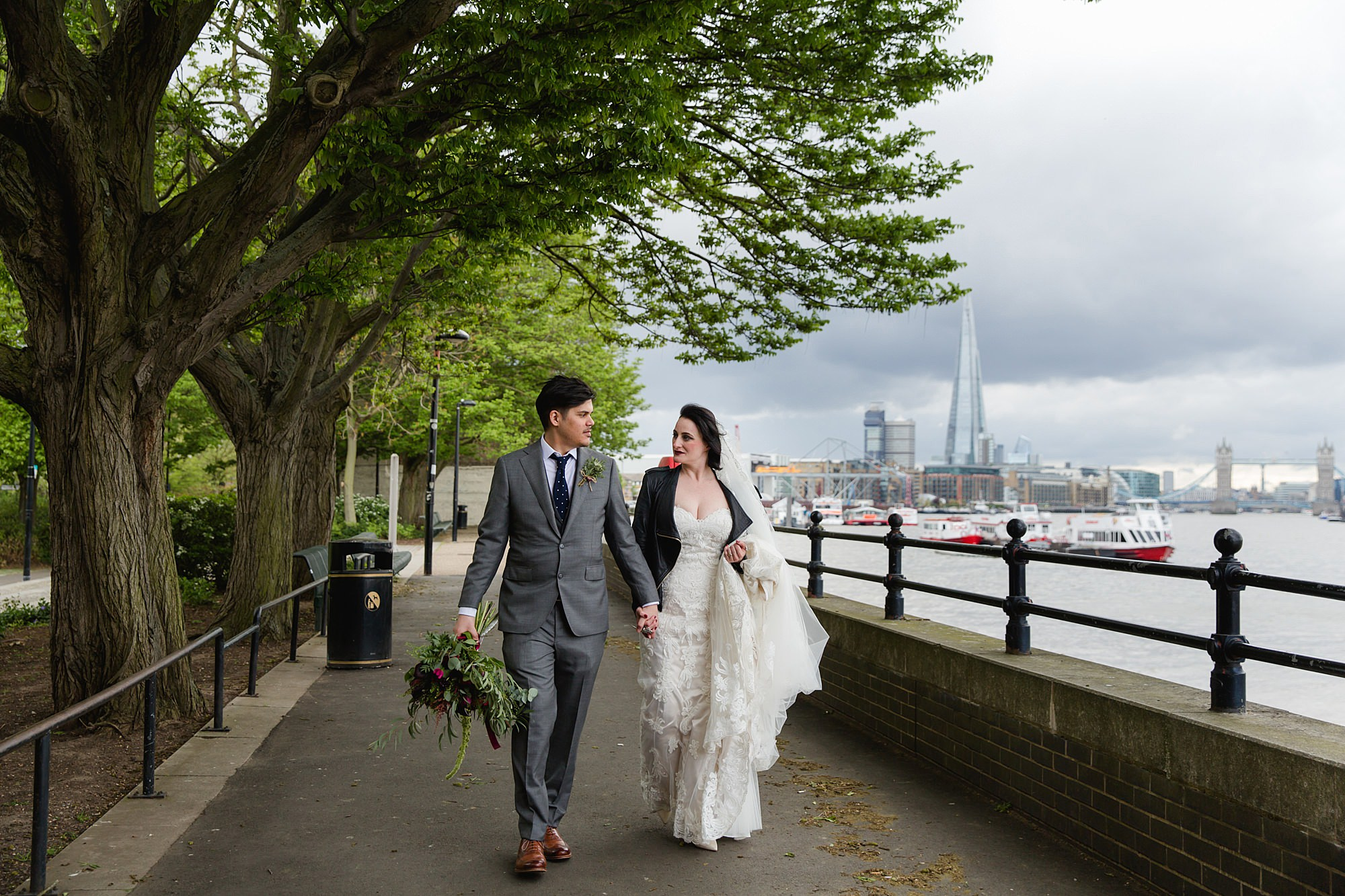 Brunel museum wedding bride and groom walking by the Thames