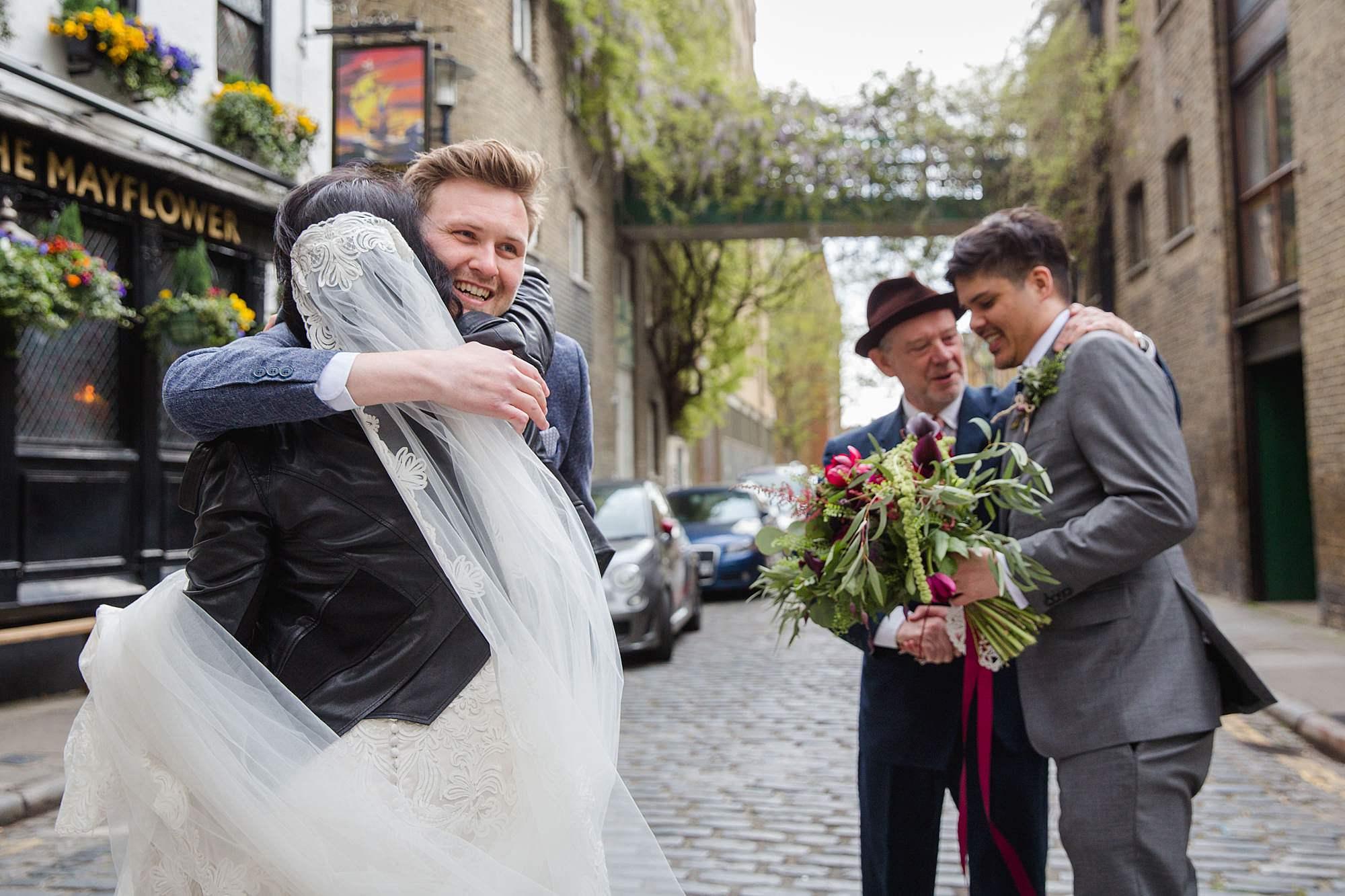 Brunel museum wedding guests hugging groom and bride