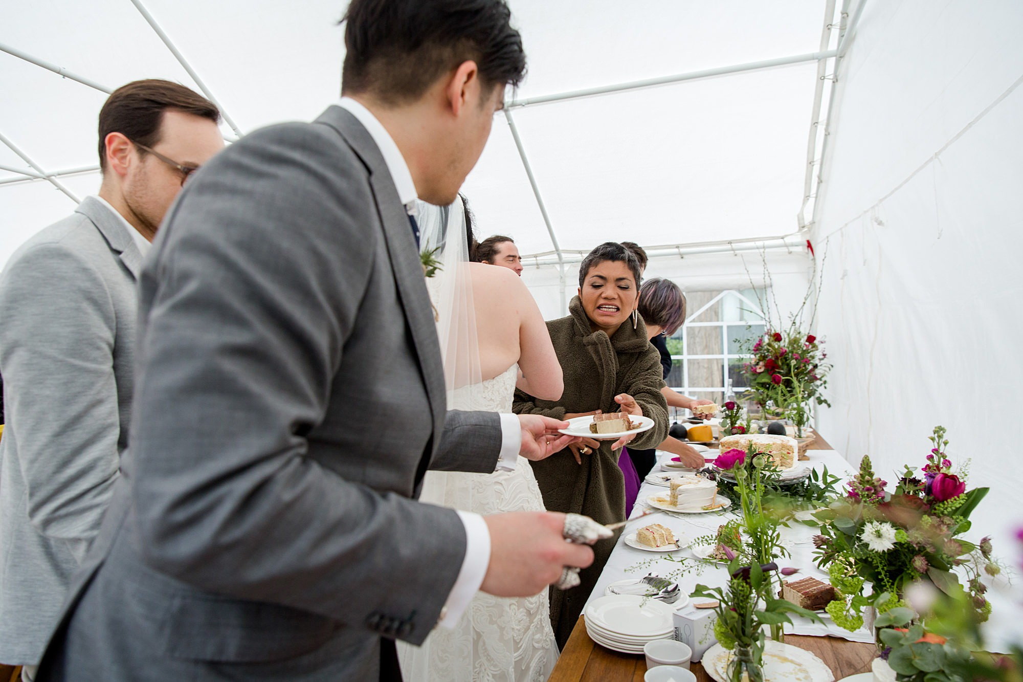 Brunel museum wedding groom cuts cake and serves to guests