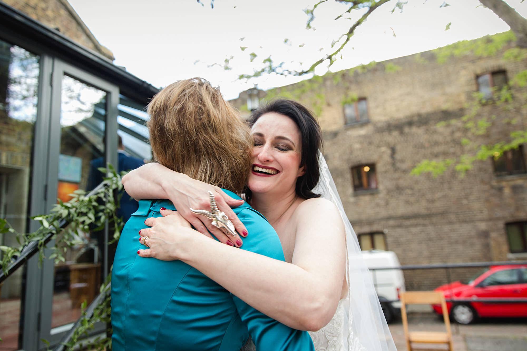bride hugging guest at Brunel museum wedding