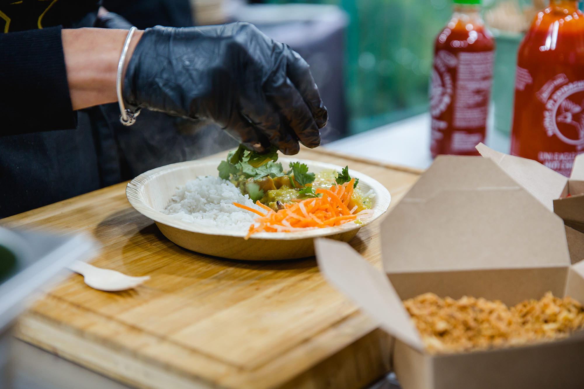 hands preparing vietnamese street food