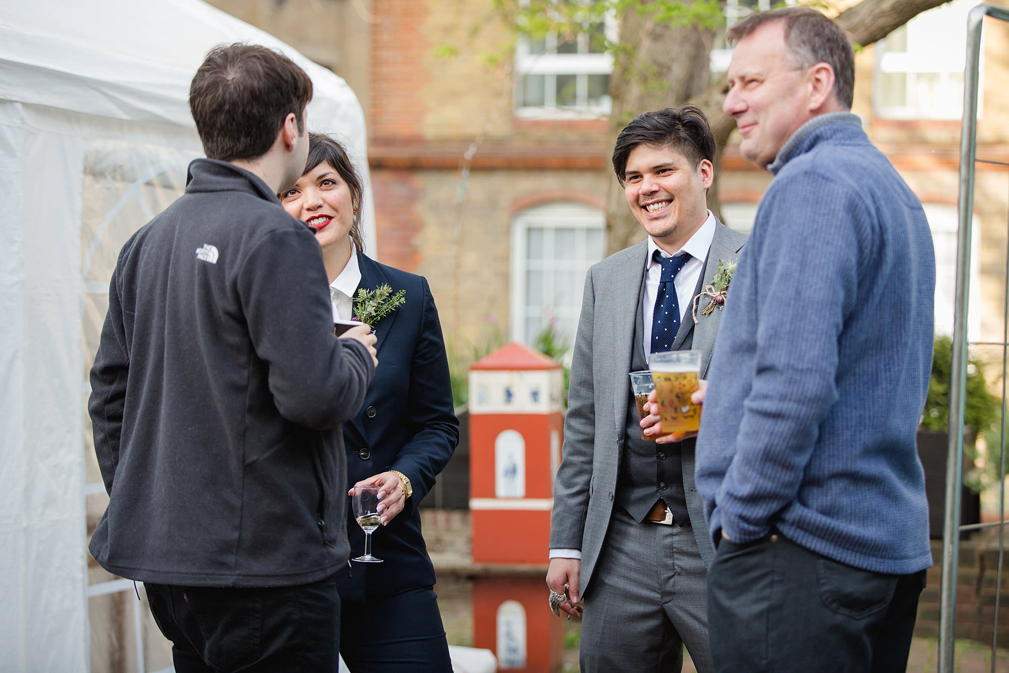 groom chatting to guests at brunel wedding