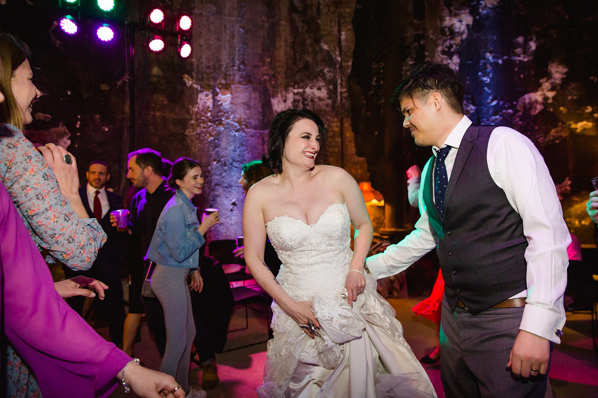 Brunel museum wedding bride and groom dance and laugh together