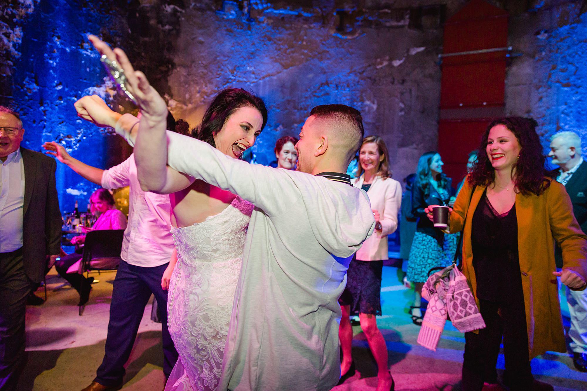 Brunel museum wedding guest dances with bride