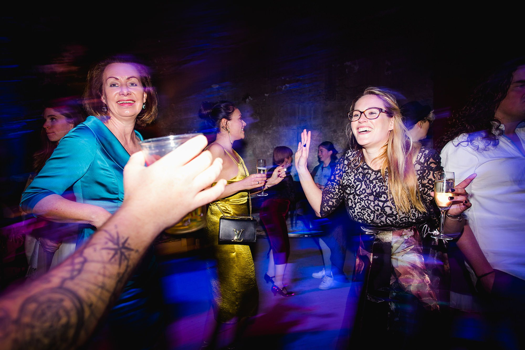 Brunel museum wedding guests dance together